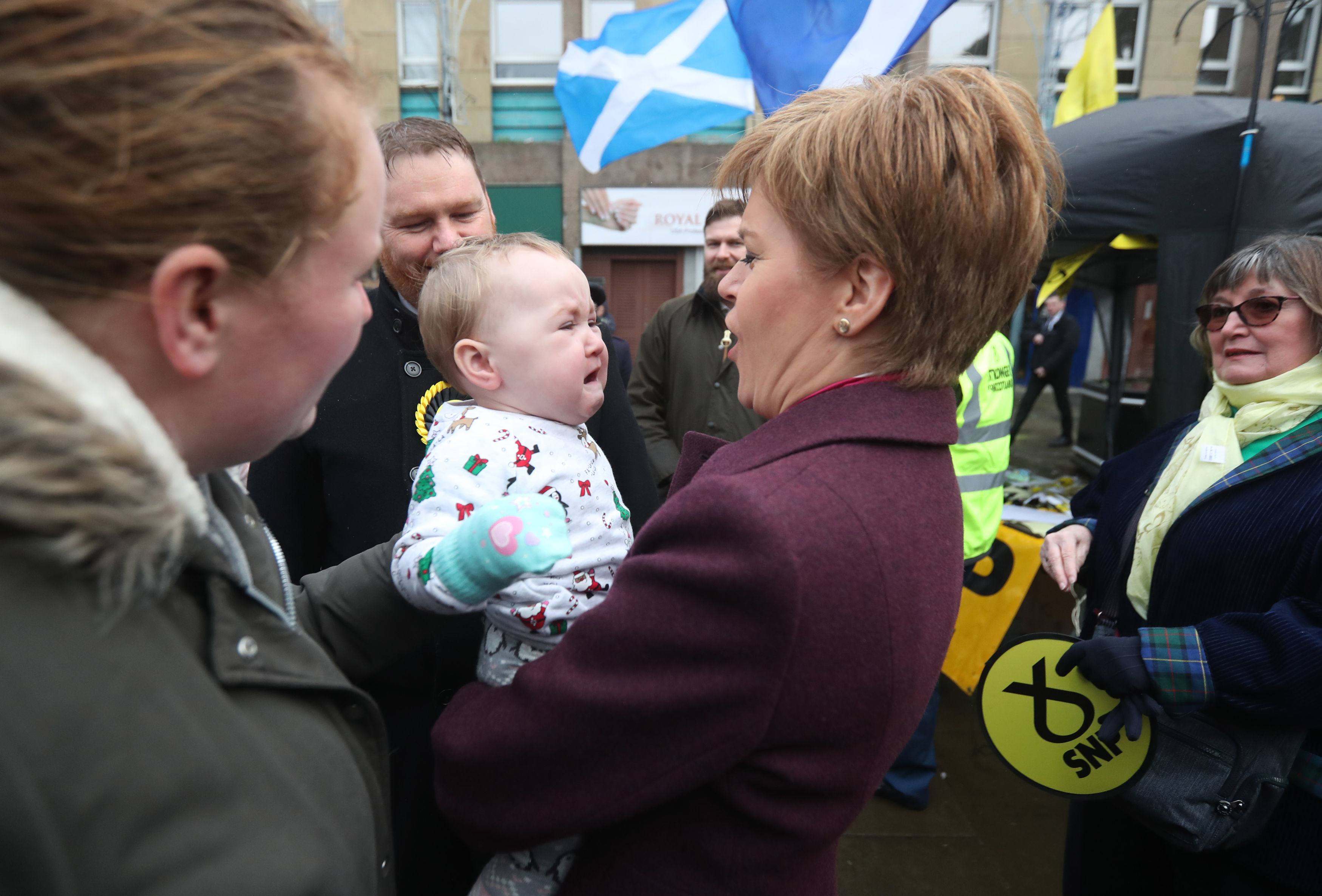 SNP leader Nicola Sturgeon holds a baby in Dalkeith, while on the General Election campaign trail in Scotland. PA Photo. Picture date: Wednesday December 4, 2019. See PA story POLITICS Election . Photo credit should read: Andrew Milligan/PA Wire