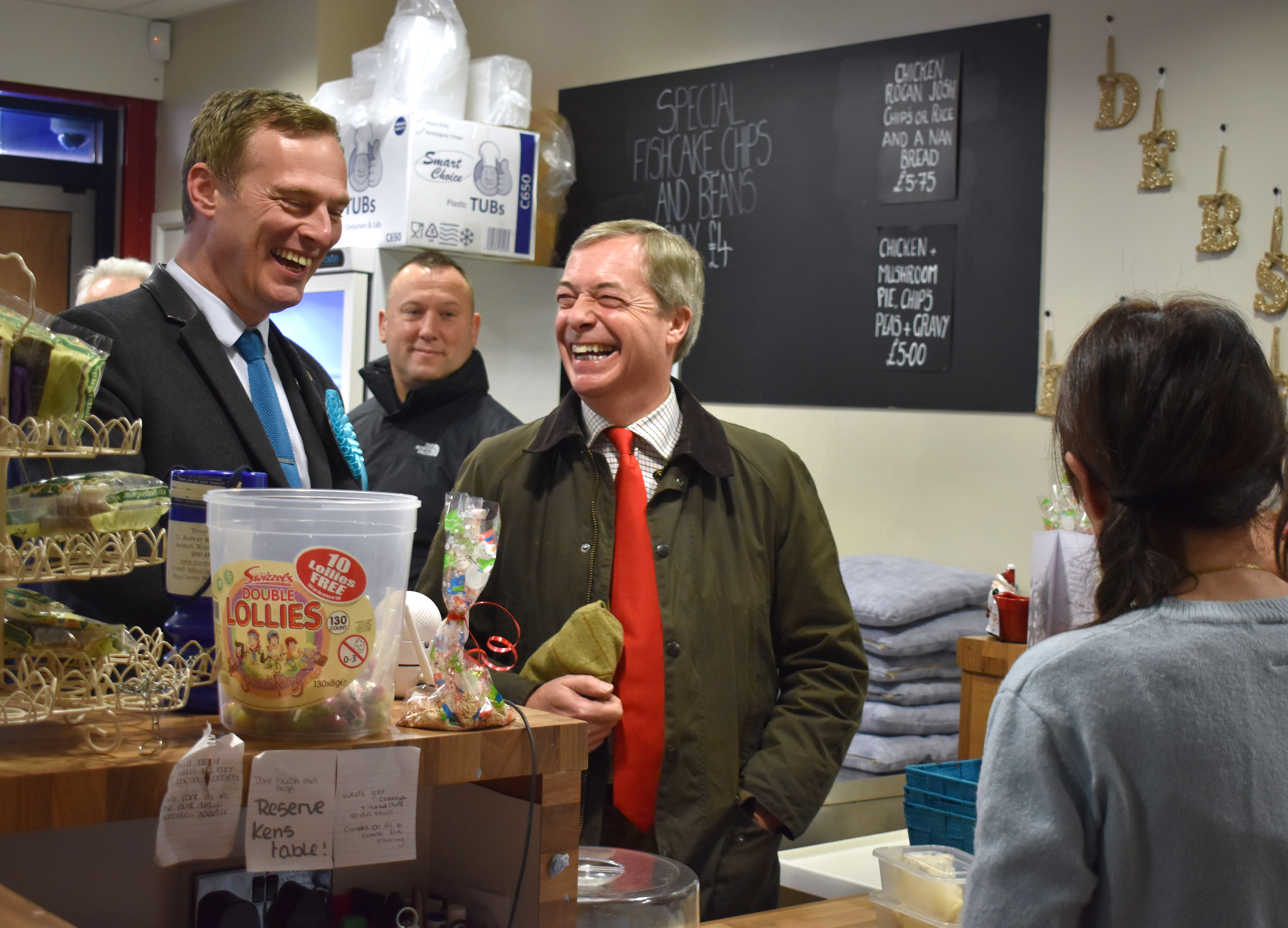 Brexit Party leader Nigel Farage (centre) in Deb's Diner in Sutton-in-Ashfield, Nottinghamshire, with party candidate in the area, MEP Martin Daubney (left) while election campaigning ahead of the General Election.