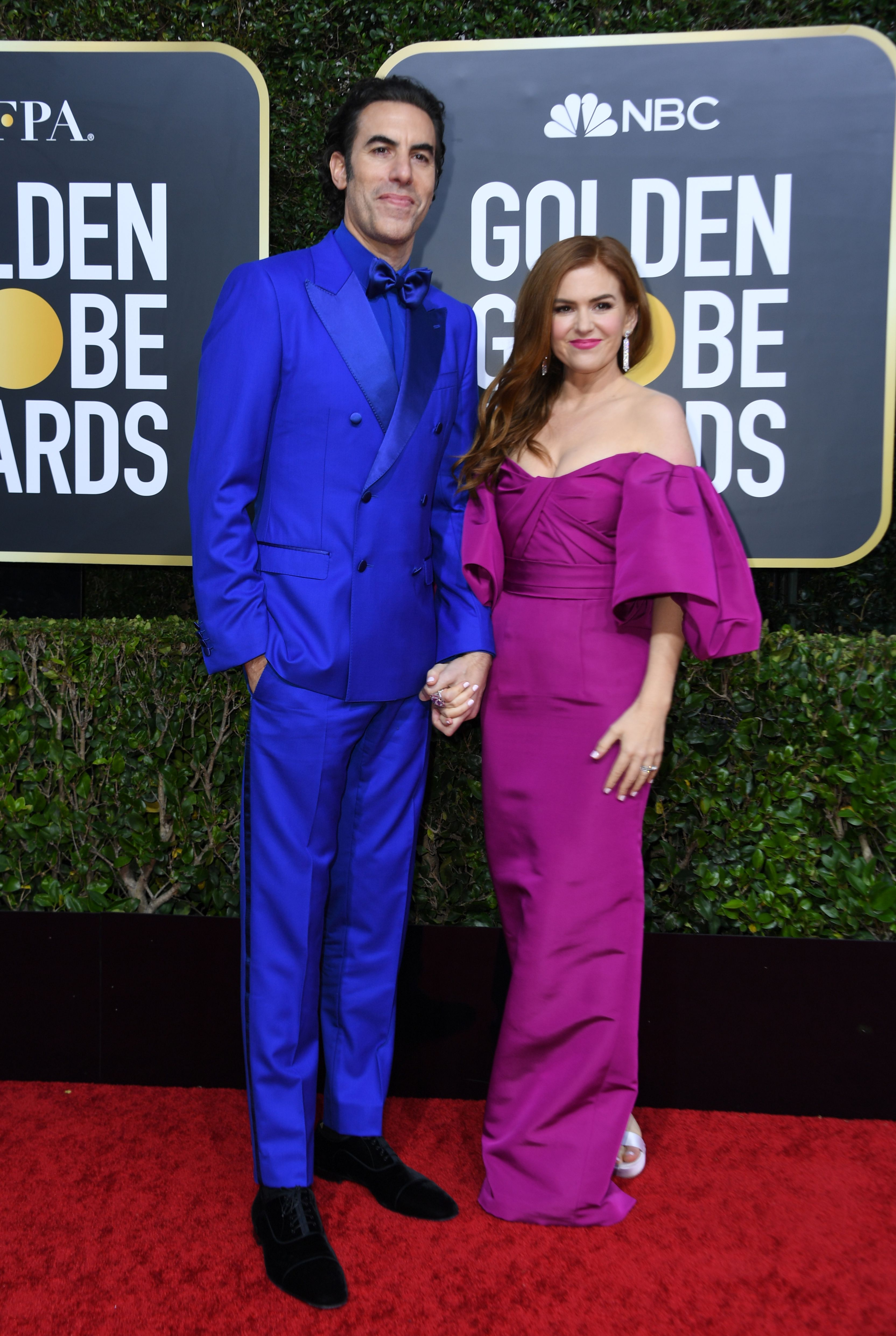 Actor Sacha Baron Cohen and his wife actress Isla Fisher arrive for the 77th annual Golden Globe Awards on January 5, 2020, at The Beverly Hilton hotel in Beverly Hills, California. (Photo by VALERIE MACON / AFP) (Photo by VALERIE MACON/AFP via Getty Images)
