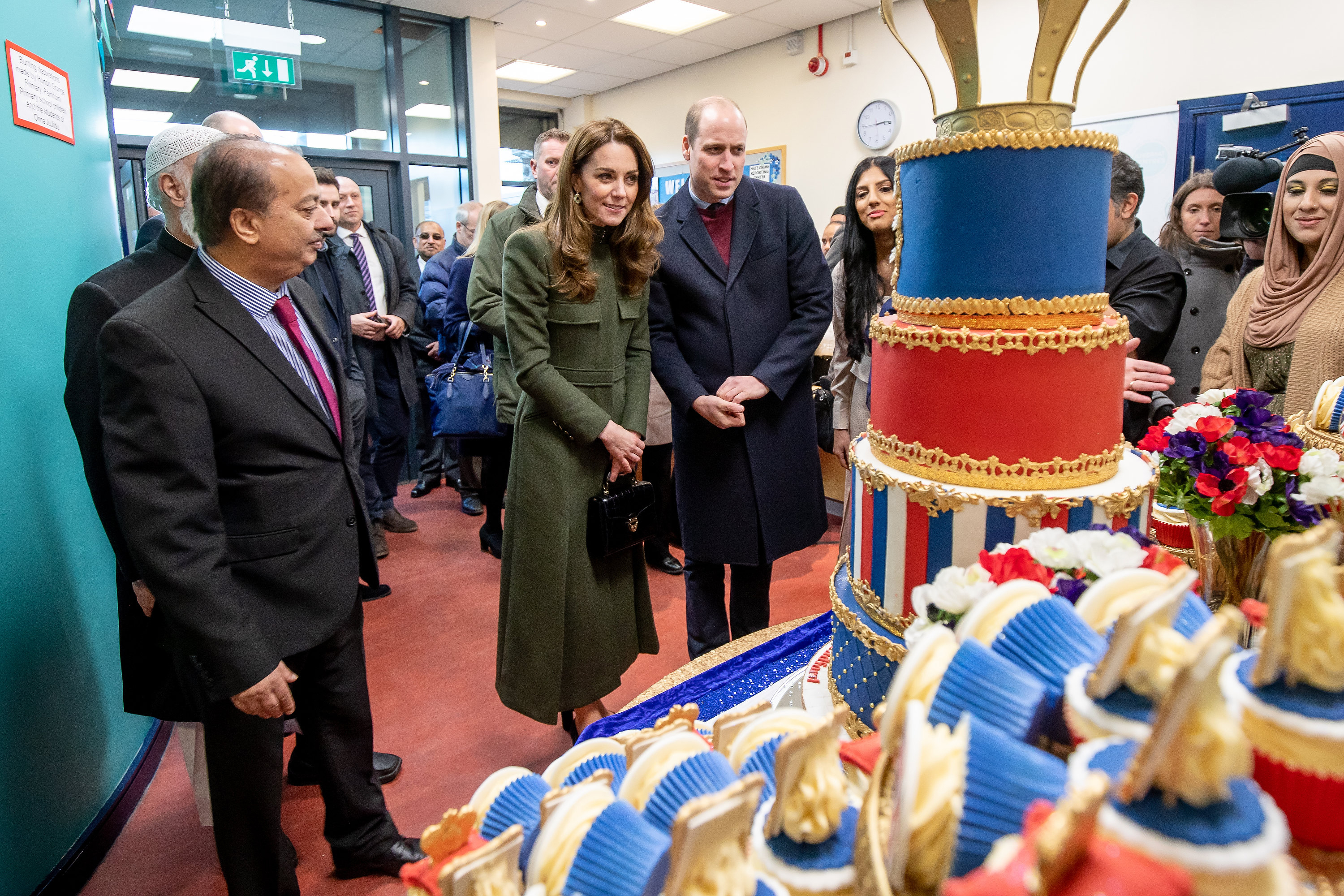 BRADFORD, ENGLAND - JANUARY 15: Prince William, Duke of Cambridge and Catherine, Duchess of Cambridge inspect cakes as they visit the Khidmat Centre on January 15, 2020 in Bradford, United Kingdom. (Photo by Charlotte Graham - WPA Pool/Getty Images)