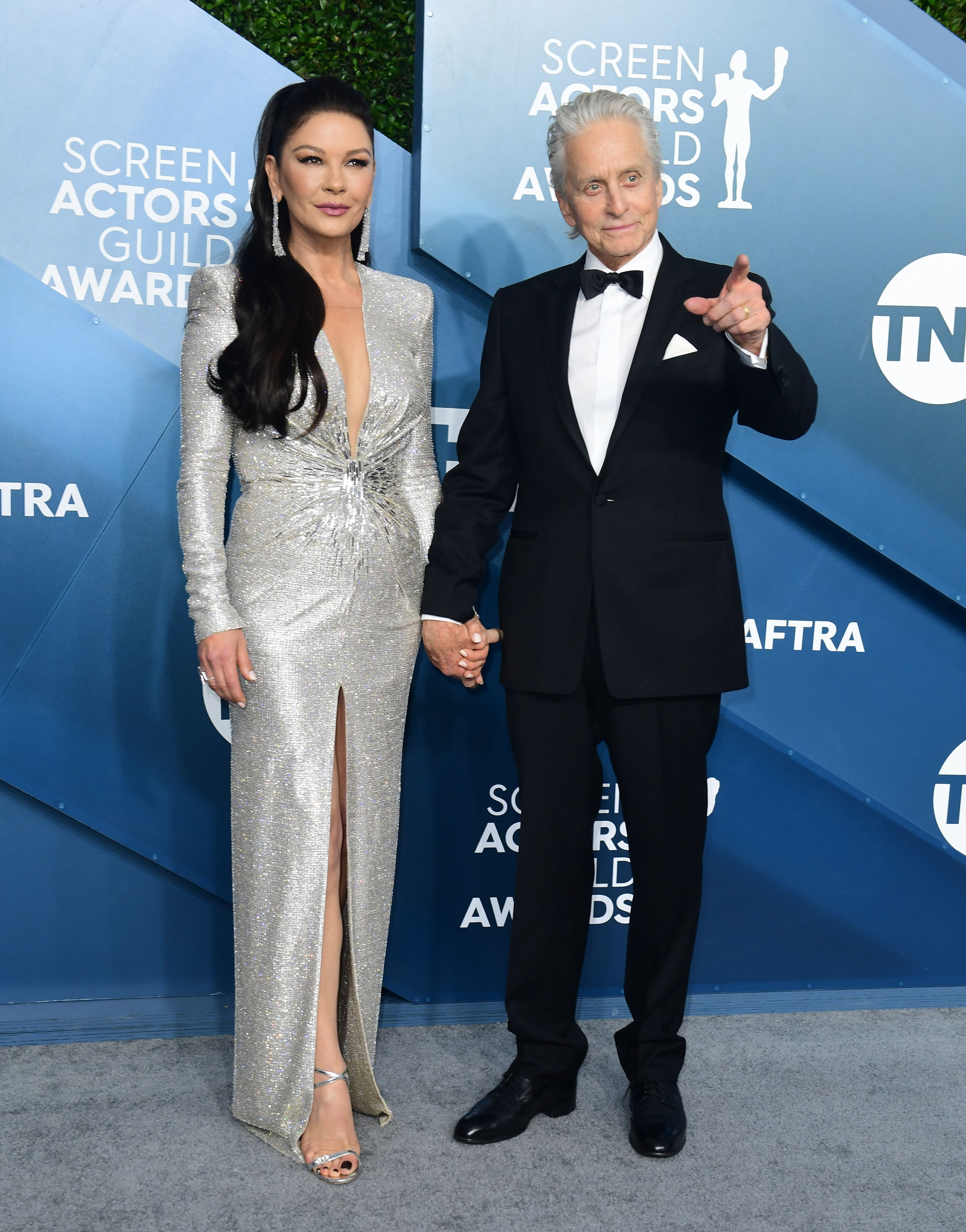 US actor Michael Douglas and his wife actress Catherine Zeta-Jones arrive for the 26th Annual Screen Actors Guild Awards at the Shrine Auditorium in Los Angeles on January 19, 2020. (Photo by FREDERIC J. BROWN / AFP) (Photo by FREDERIC J. BROWN/AFP via Getty Images)