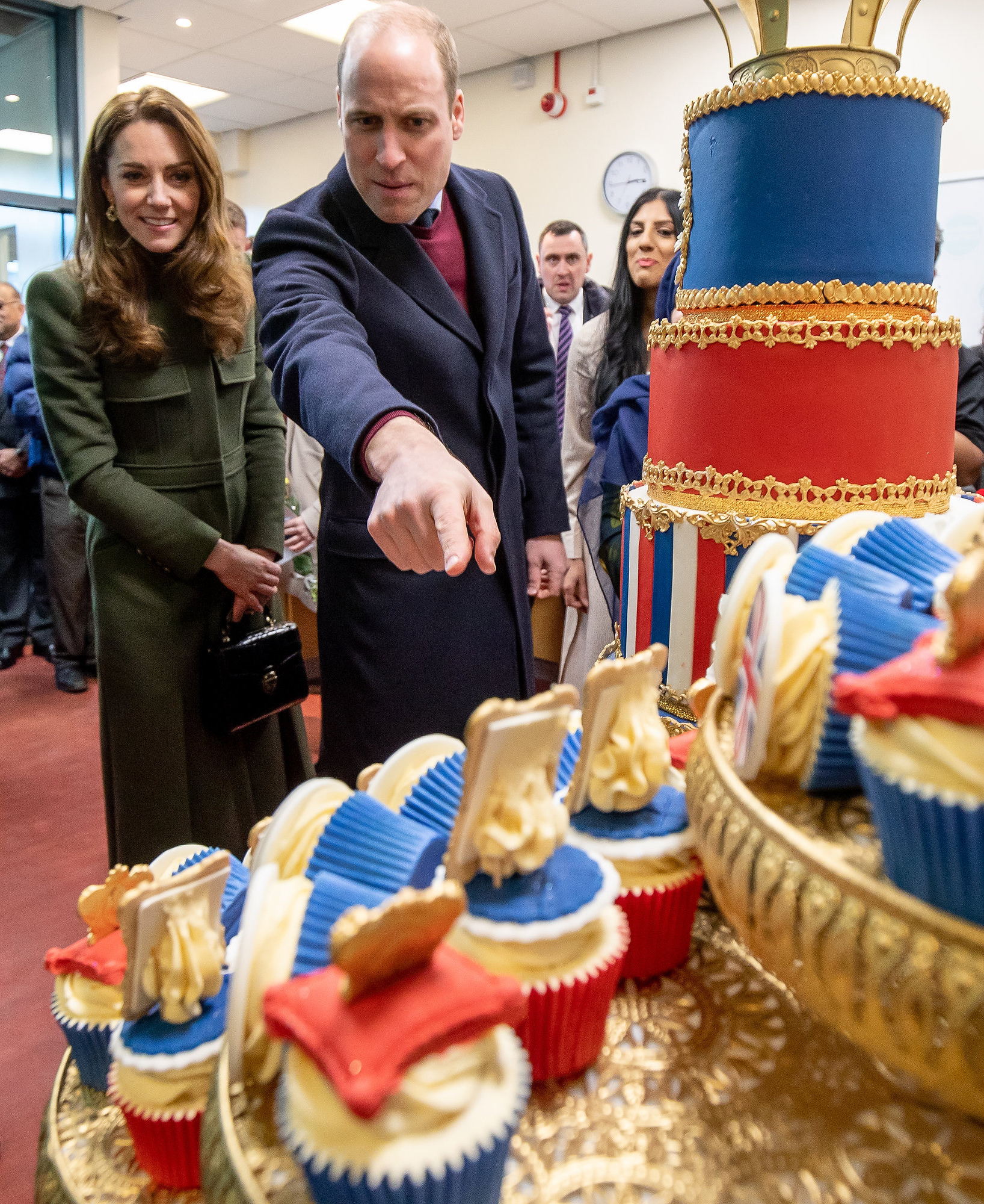 Britain's Prince William, Duke of Cambridge and Britain's Catherine, Duchess of Cambridge react during their visit to the Khidmat Centre in Bradford on January 15, 2020, to learn about the activities and workshops offered by the centre. (Photo by Charlotte Graham / POOL / AFP) (Photo by CHARLOTTE GRAHAM/POOL/AFP via Getty Images)