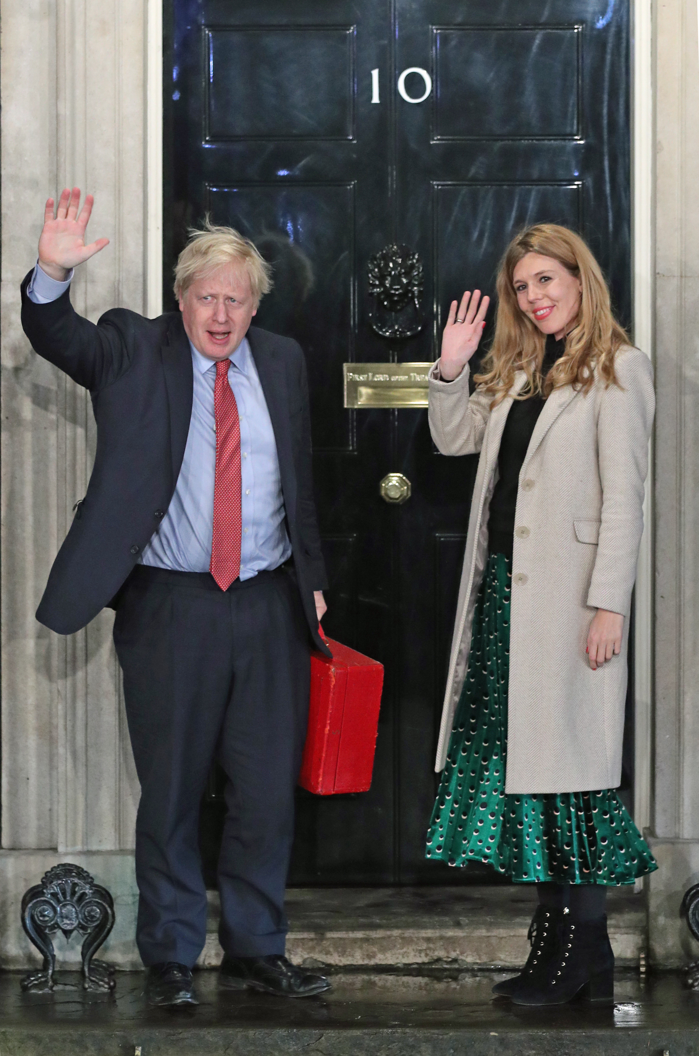 Prime Minister Boris Johnson and his girlfriend Carrie Symonds arrive in Downing Street after the Conservative Party was returned to power in the General Election with an increased majority.