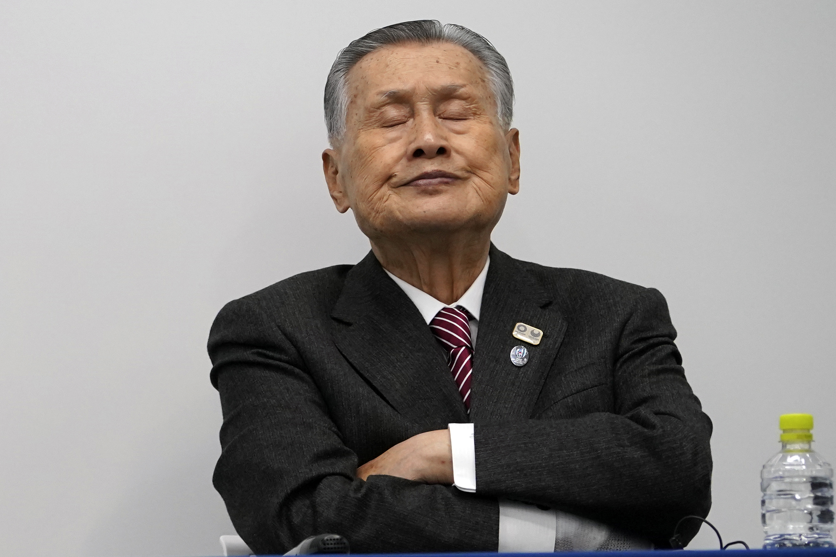 Tokyo 2020 Olympics chief Yoshiro Mori listens to questions from journalist during a press conference Monday, March 23, 2020, in Tokyo. As infections soared in Europe and the United States and the world economy spiraled downward, Japan on Monday hinted at the next possible victim of the globe-spanning coronavirus: The 2020 Tokyo Olympics. (AP Photo/Eugene Hoshiko)