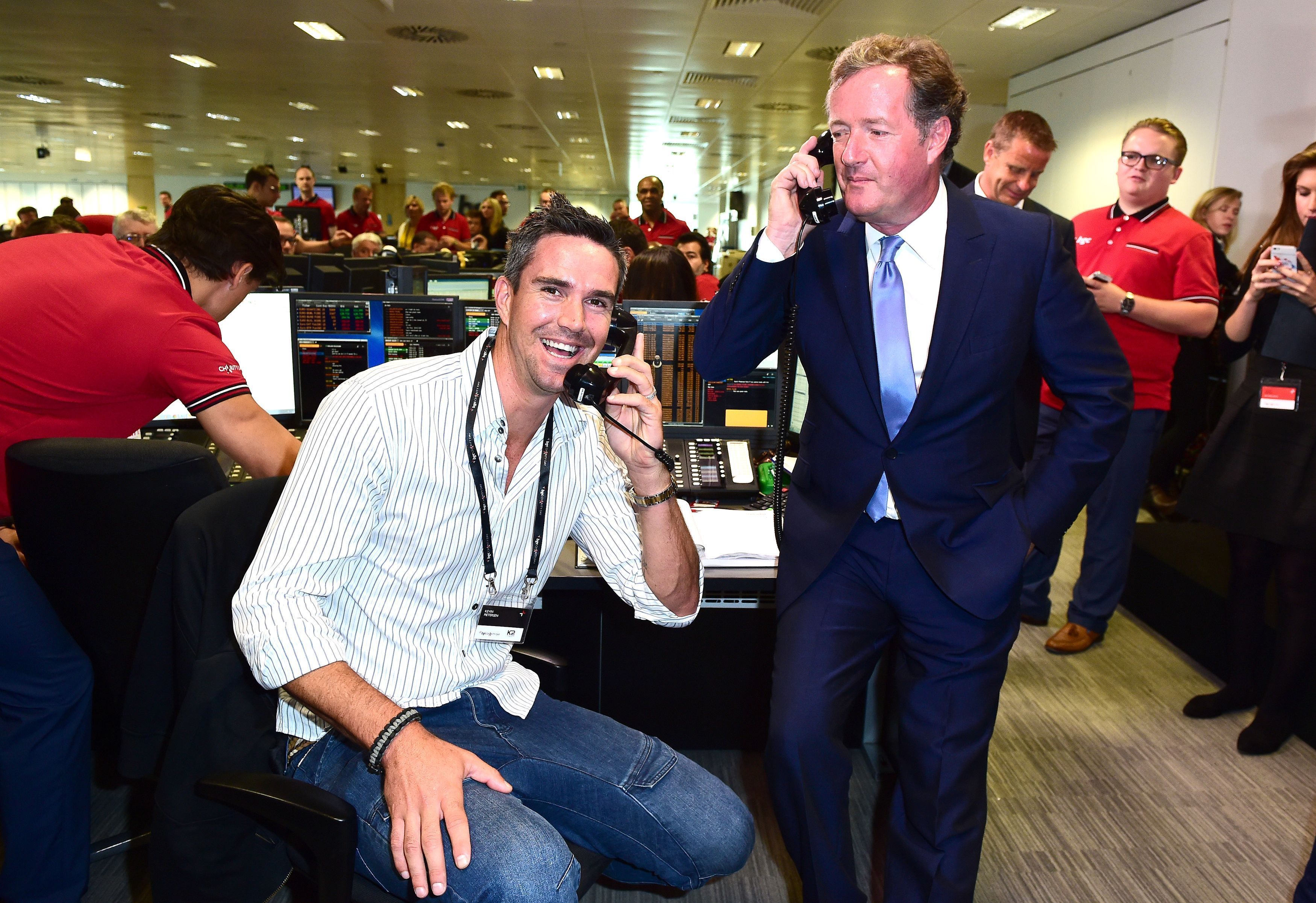 Kevin Pietersen (left) and Piers Morgan take part in the BGC Annual Global Charity Day at Canary Wharf in London.