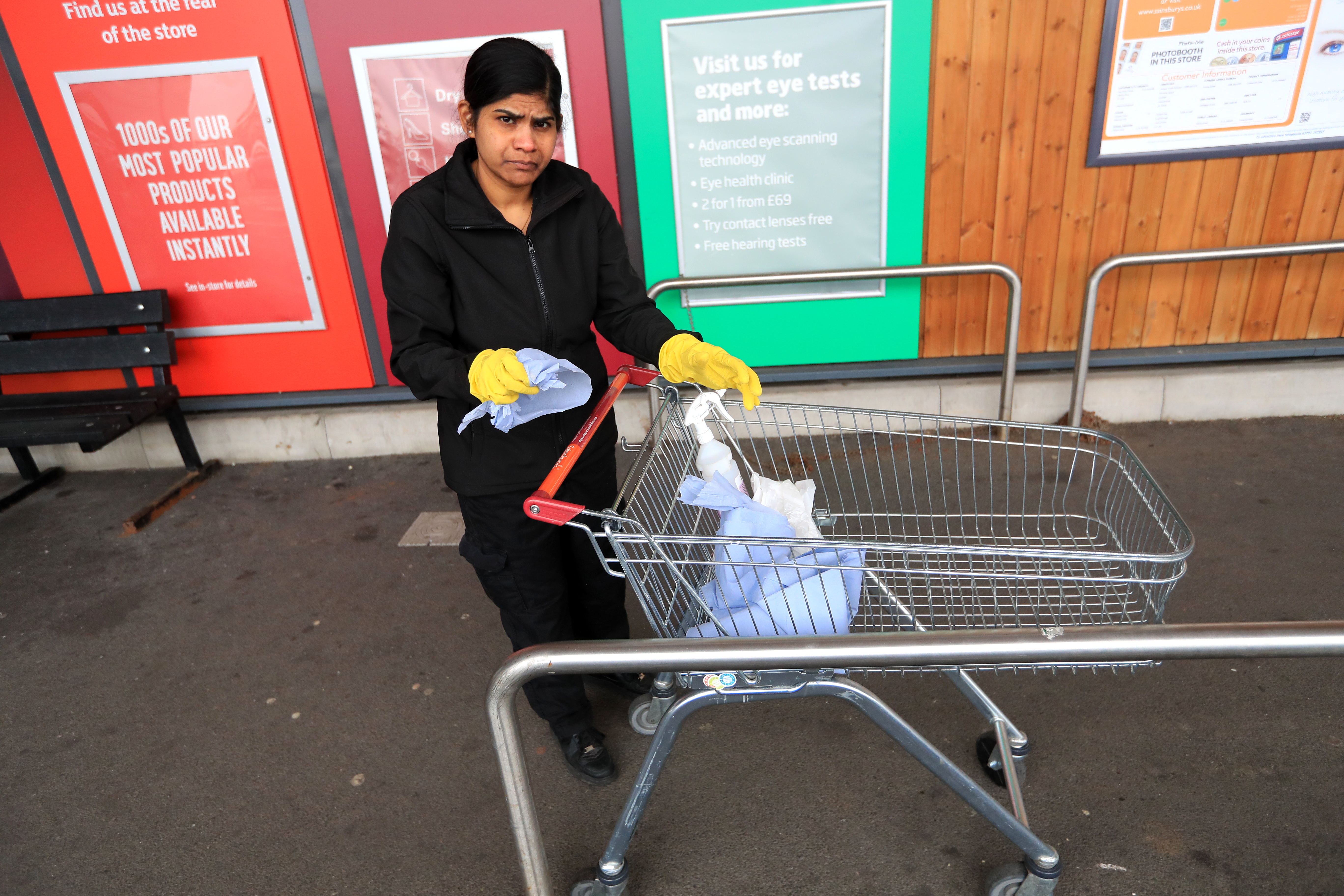 Trollies are being disinfected at a Sainsburys in Leicester after NHS England announced that the coronavirus death toll had reached 104 in the UK.