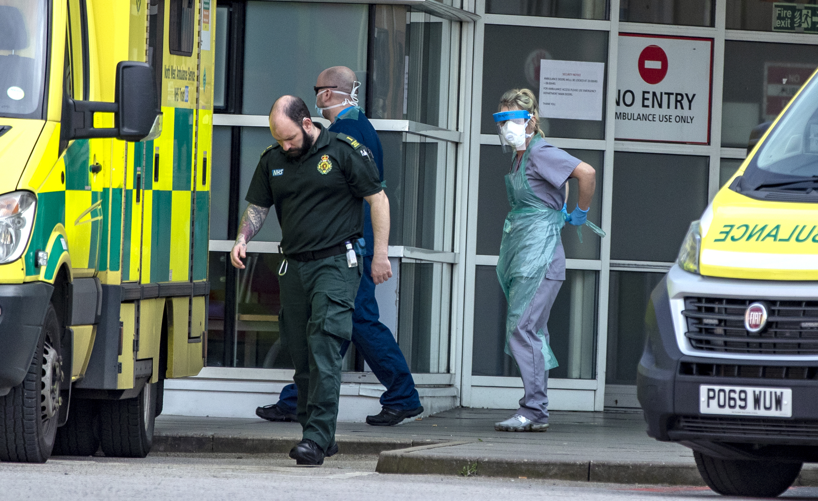 Hospital staff and ambulance staff prepare to take a patient into the Royal Liverpool University Hospital, as Prime Minister Boris Johnson has said the Government is ready to impose tougher restrictions to curb the spread of the coronavirus if people do not follow the guidance on social distancing.