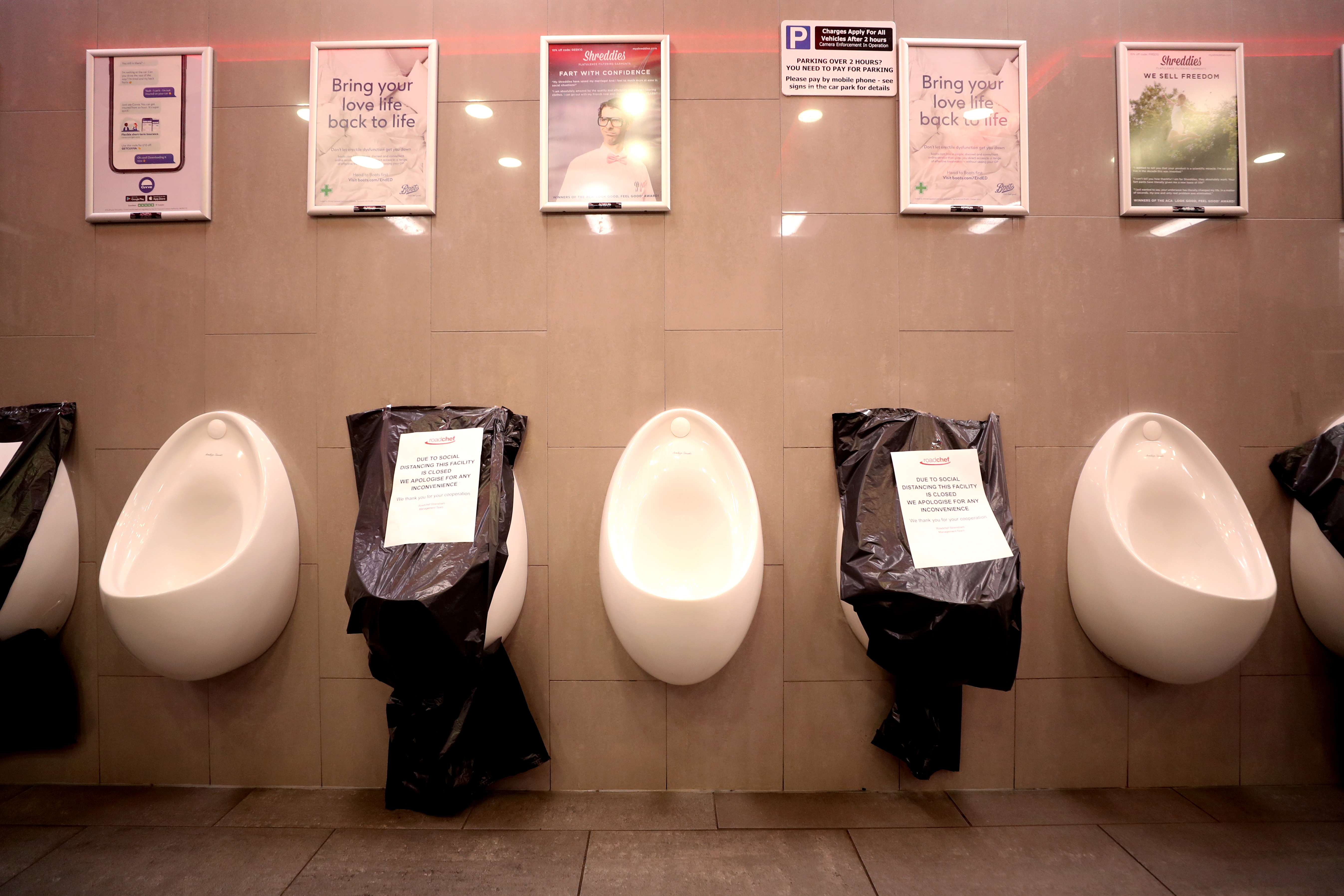 The Men's toilet facilities at the Strensham Services in Worcestershire where alternate urinals are out of use to maintain social distancing as the UK continues in lockdown to help curb the spread of the coronavirus.