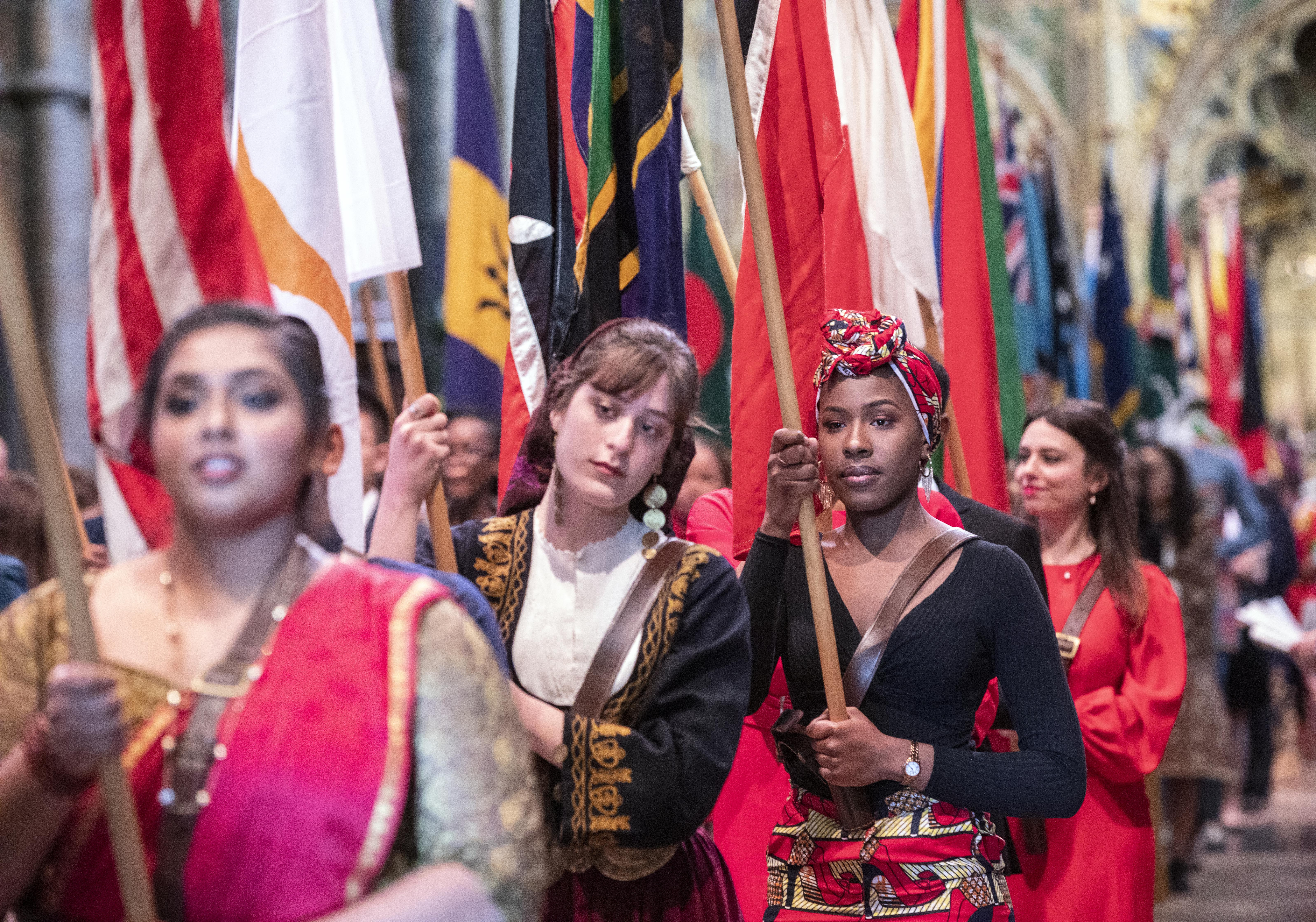 Flag bearers carrying the flags of the Commonwealth during the Commonwealth Service at Westminster Abbey, London.