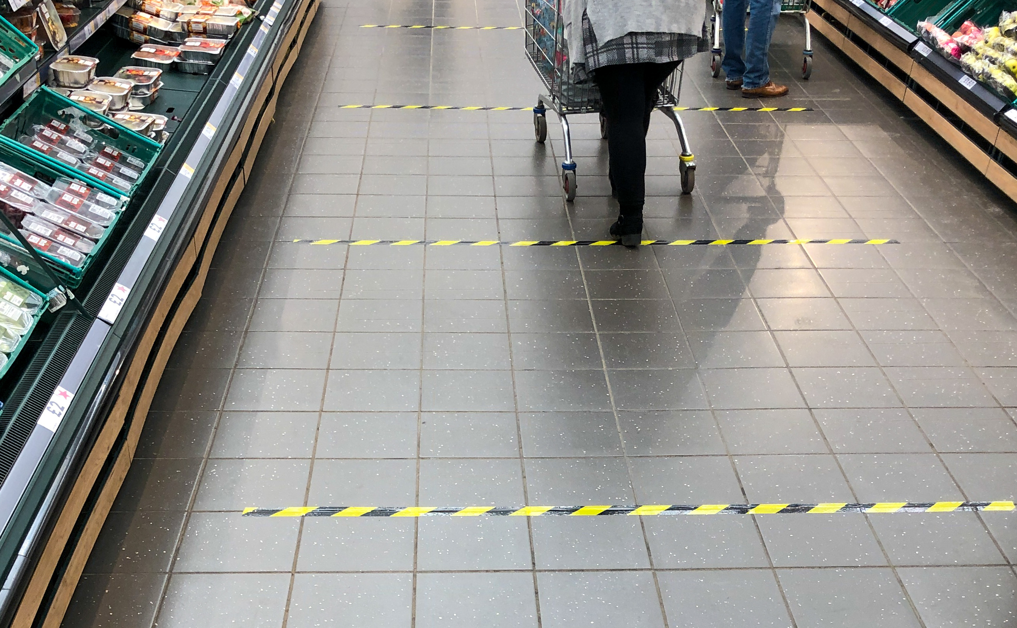 Tape marks out 2 metre sections on the floor to implement social distancing measures at a Tesco store in Peterborough, after Prime Minister Boris Johnson has put the UK in lockdown to help curb the spread of the coronavirus.