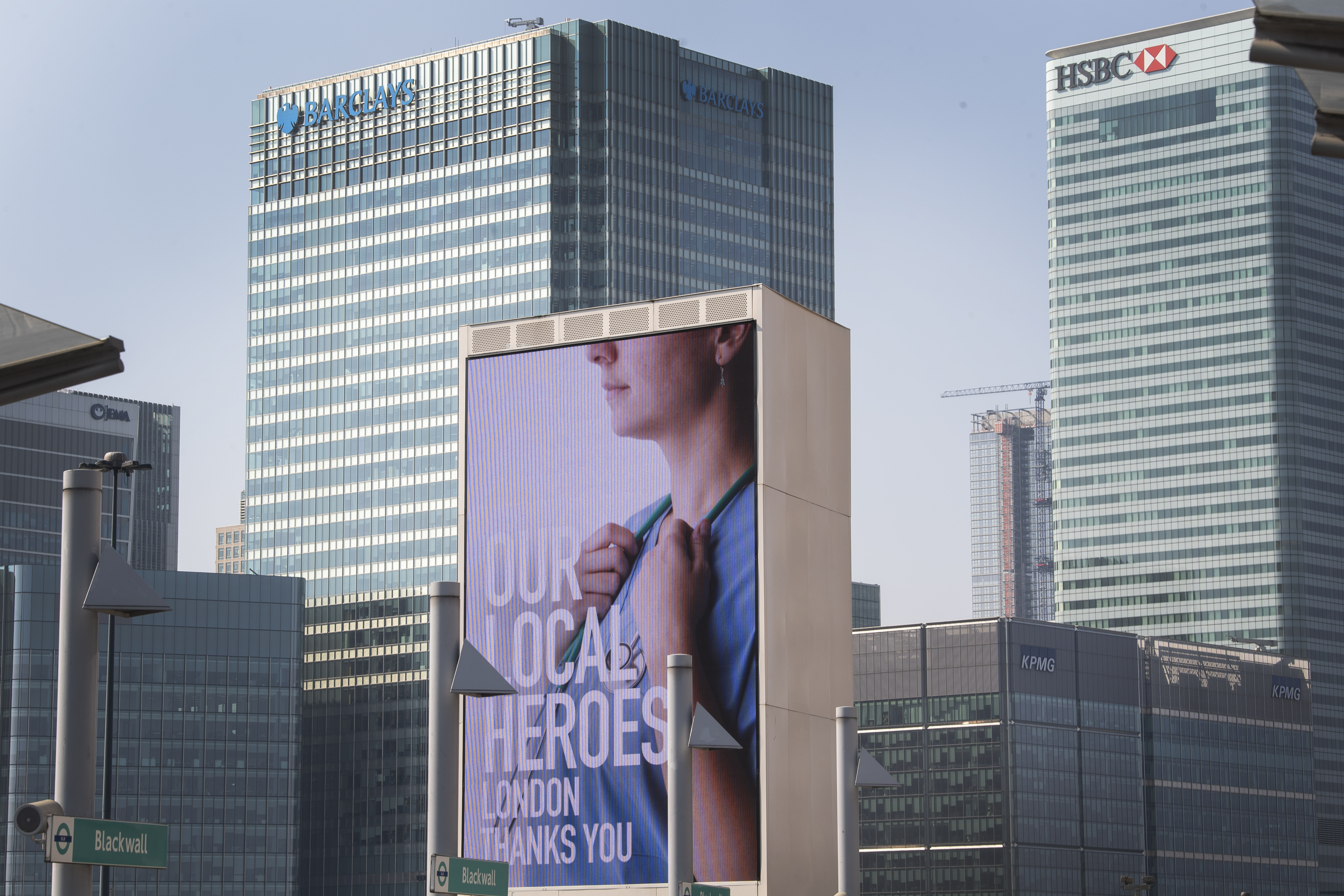 Information screens saluting local heroes on a main road passing Canary Wharf in east London as the UK continues in lockdown to help curb the spread of the coronavirus.