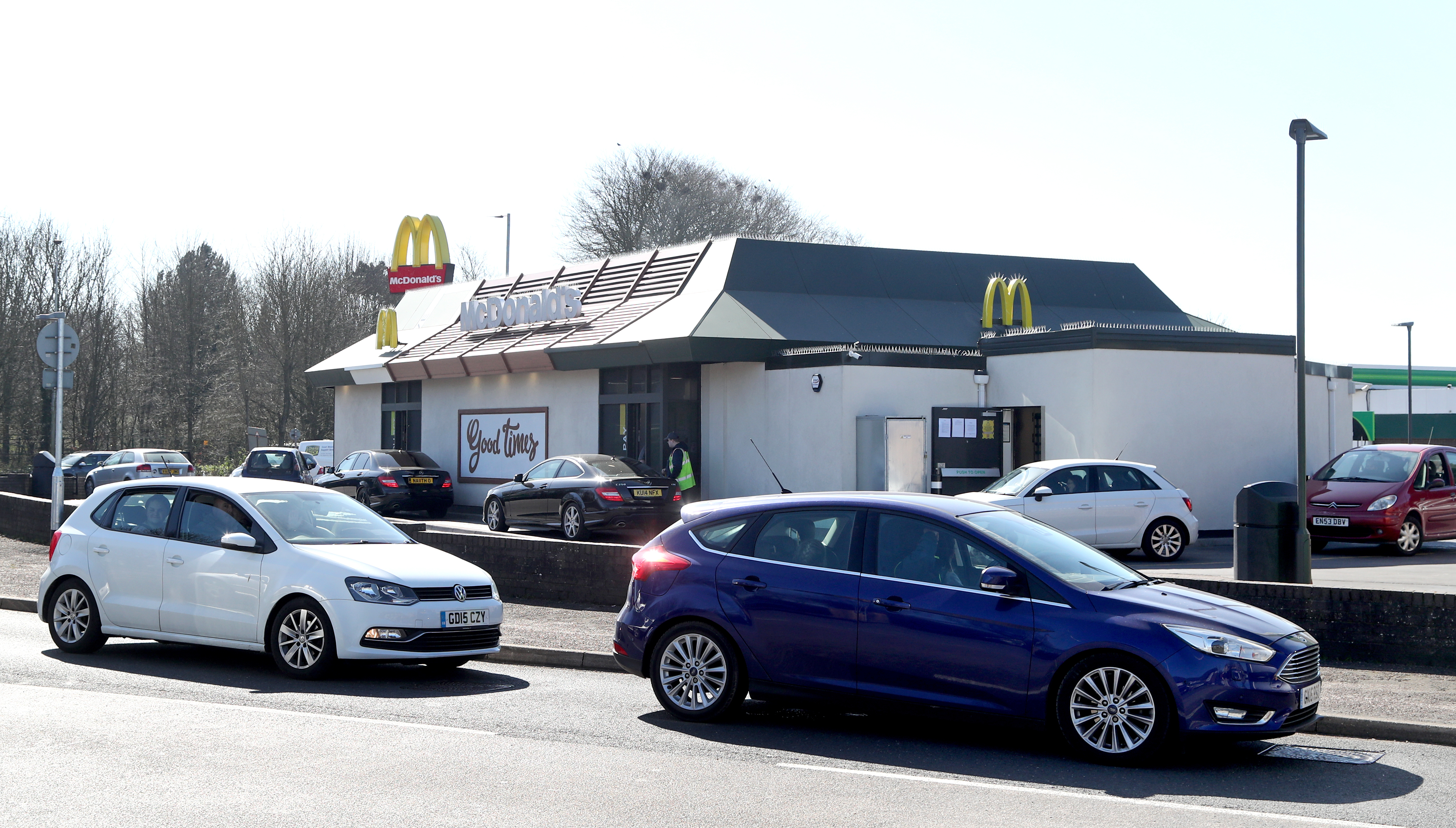 Drivers form a long queue to use a McDonald's drive-thru near Dover in Kent as it was announced that all of their restaurant locations in the UK and Ireland will close by 7pm on Monday to protect the safety of their employees and customers from coronavirus.