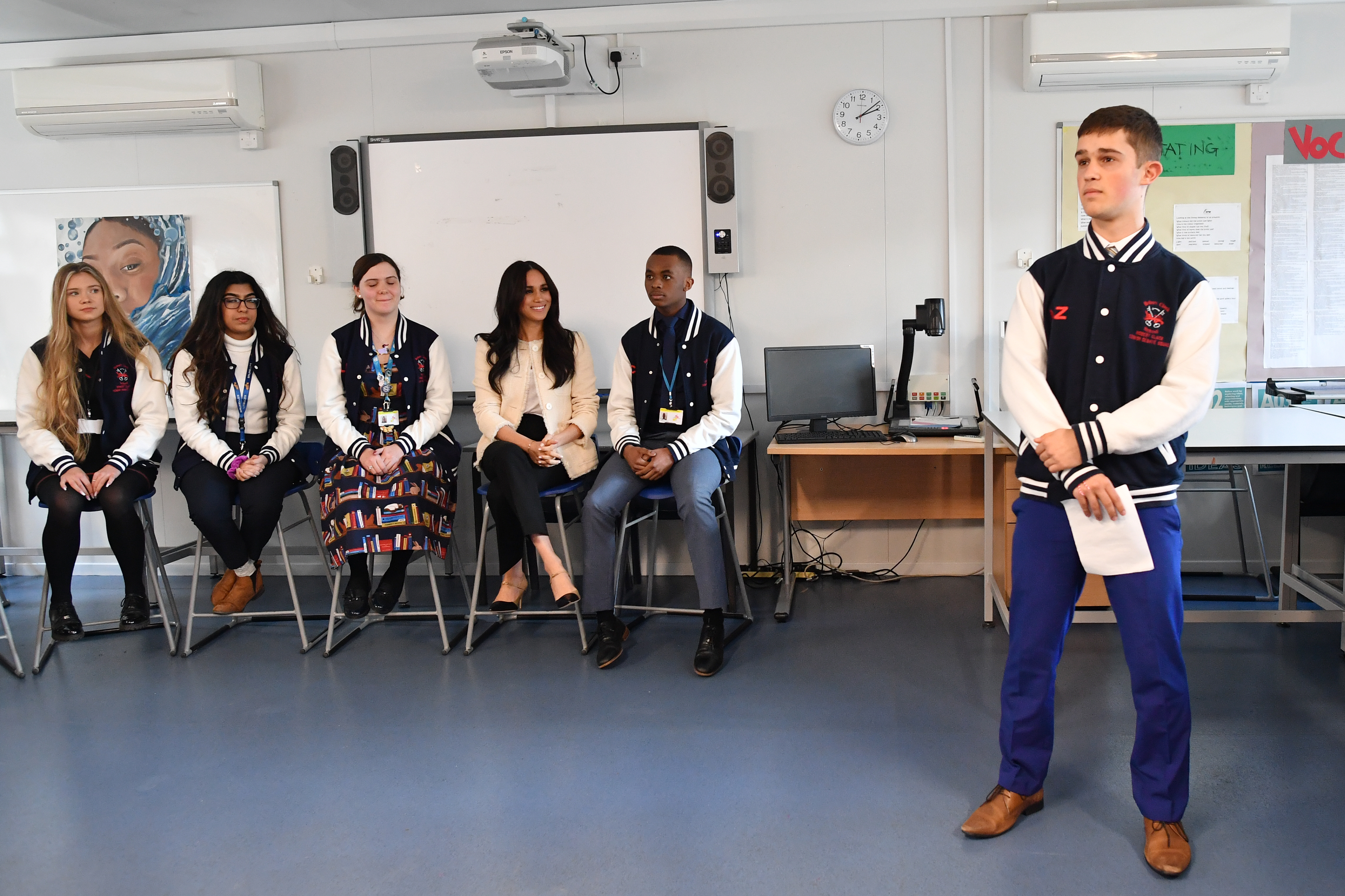 The Duchess of Sussex (fourth left) joins in a discussion of the 'Senior Debate Squad' at the Robert Clack Upper School in Dagenham, Essex, during a surprise visit to celebrate International Women's Day.