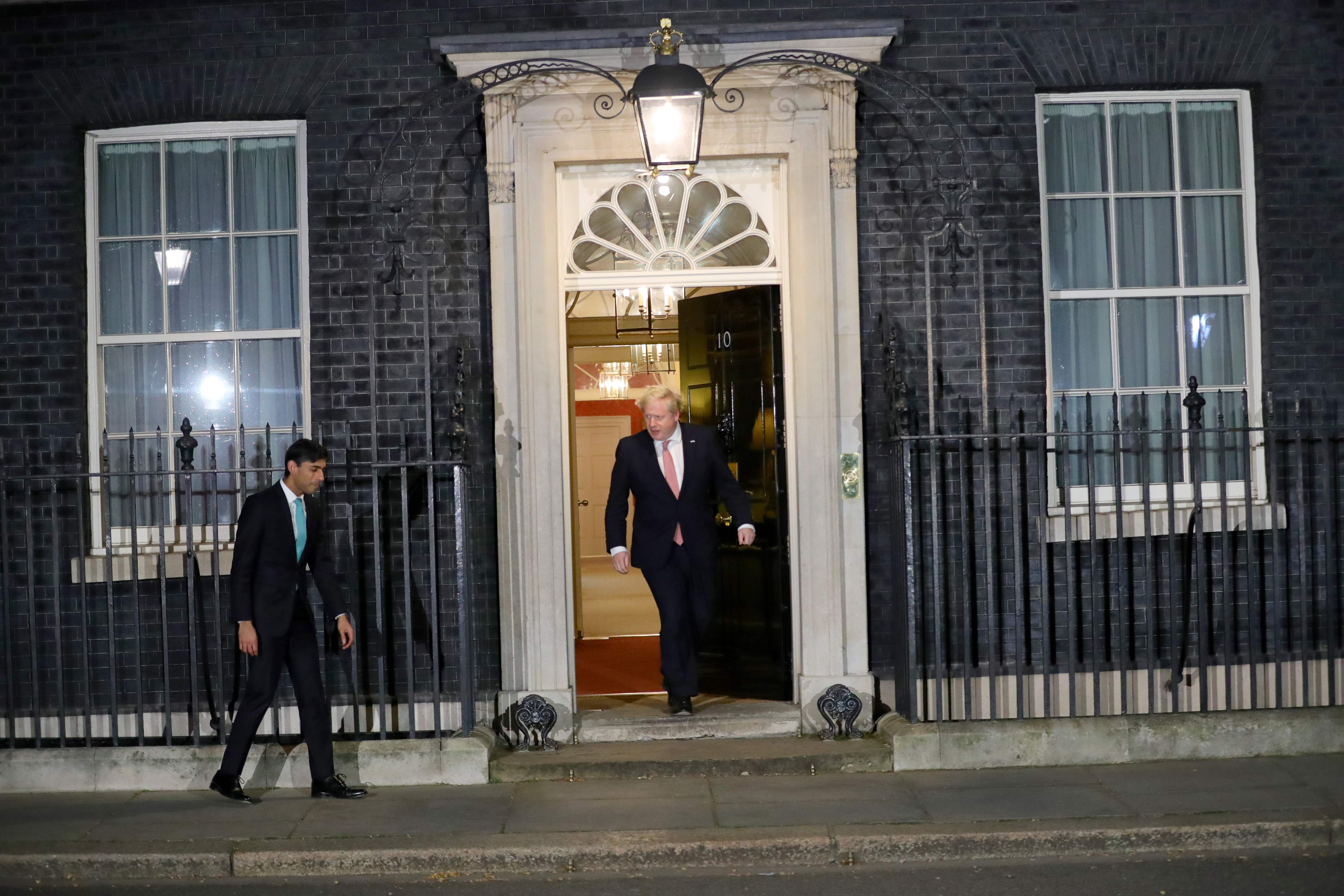 Prime Minister Boris Johnson and Chancellor Rishi Sunak outside 10 Downing Street, London, joining in with a national applause for the NHS from their doorsteps, windows and balconies to show their appreciation for all NHS workers who are helping to fight the Coronavirus.