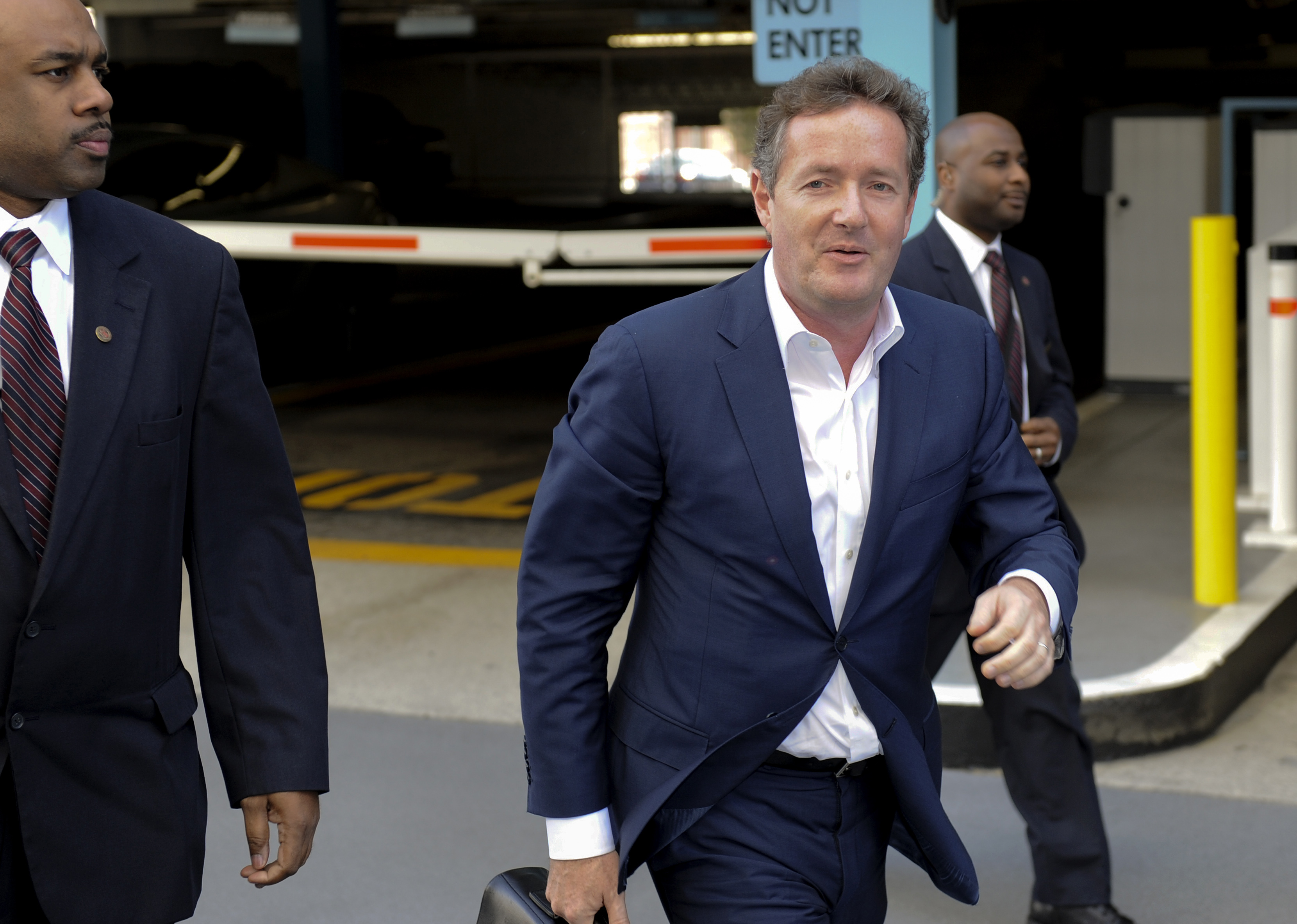 British talk show host Piers Morgan and former News of the World editor arrives for work at CNN after his British judicial inquiry in Los Angeles, California December 20, 2011. Morgan told a British judicial inquiry on Tuesday that he had never approved phone hacking during his time as a tabloid newspaper editor, and that his published boasts had merely been repeating rumours about journalistic ``dark arts.'' REUTERS/Gus Ruelas (UNITED STATES - Tags: CRIME LAW ENTERTAINMENT MEDIA)