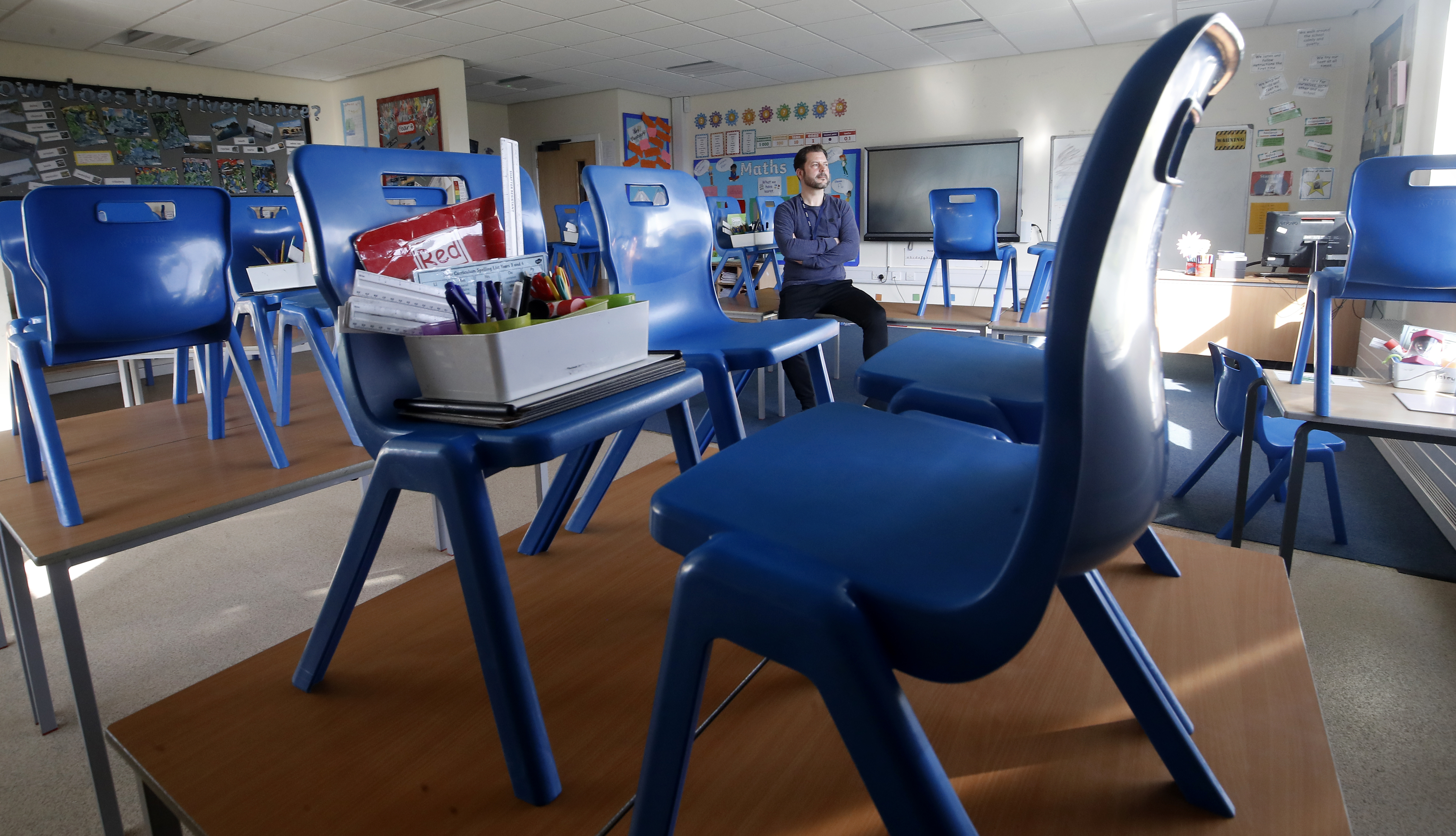 Simon Cotterill, Head Teacher of Manor Park School and Nursery in Knutsford Cheshire, sits in an empty classroom, the day after Prime Minister Boris Johnson put the UK in lockdown to help curb the spread of the coronavirus.