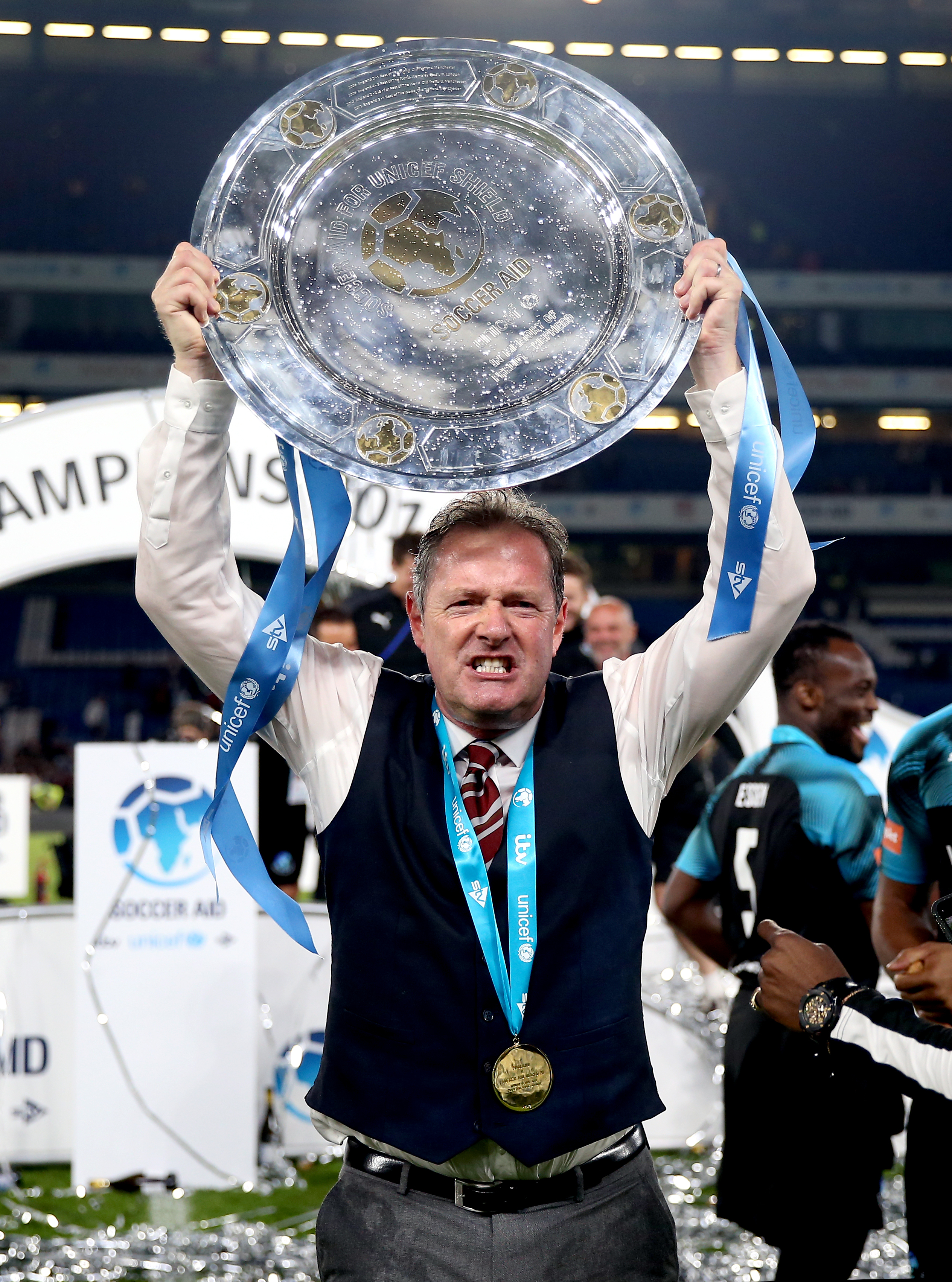 World Eleven Assistant Manager Piers Morgan celebrates with the trophy at the end of the Soccer Aid match at Stamford Bridge, London.