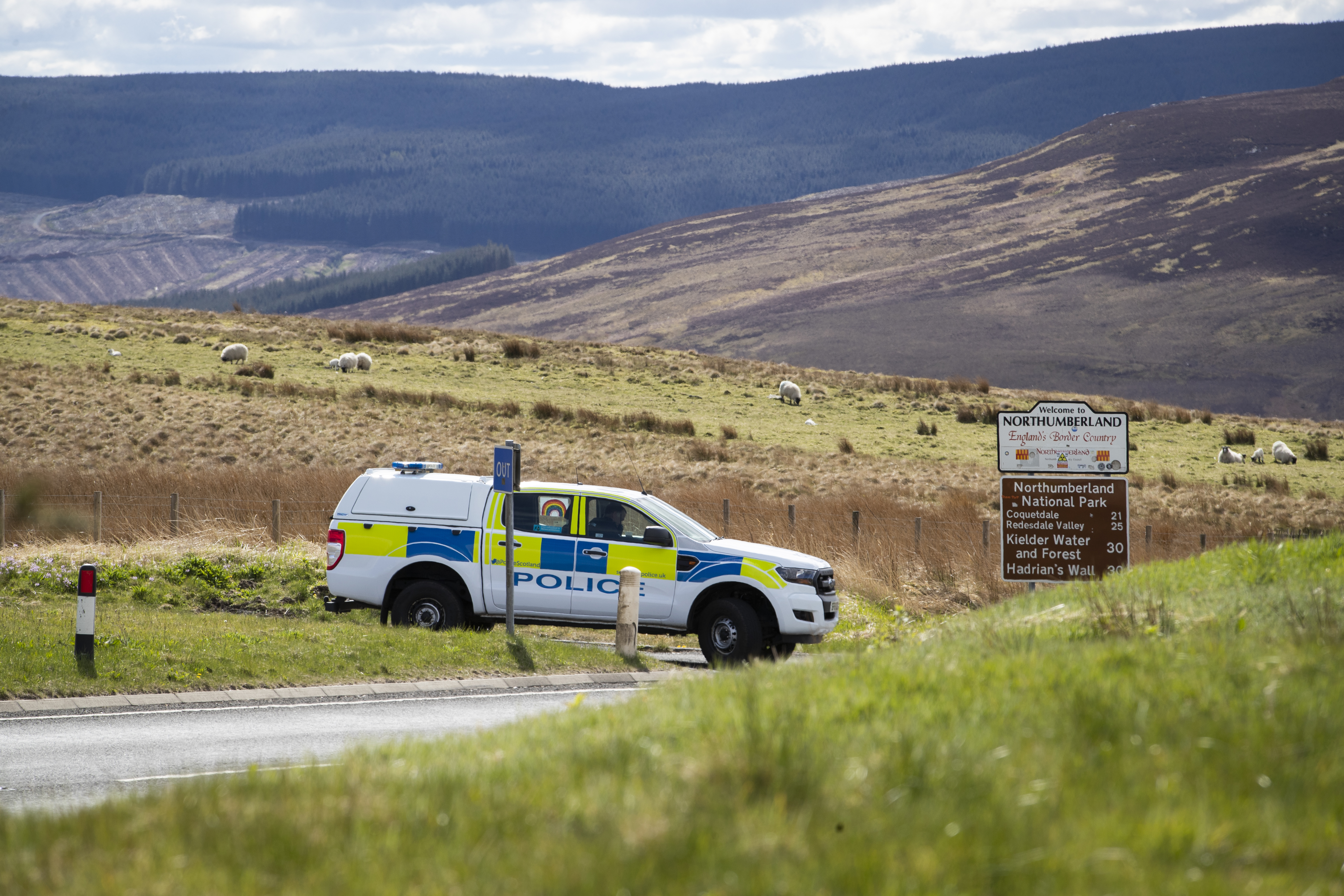 Police patrol the Scotland-England border on the A68 near Jedburgh in the Scottish Borders as the UK continues in lockdown to help curb the spread of the coronavirus.