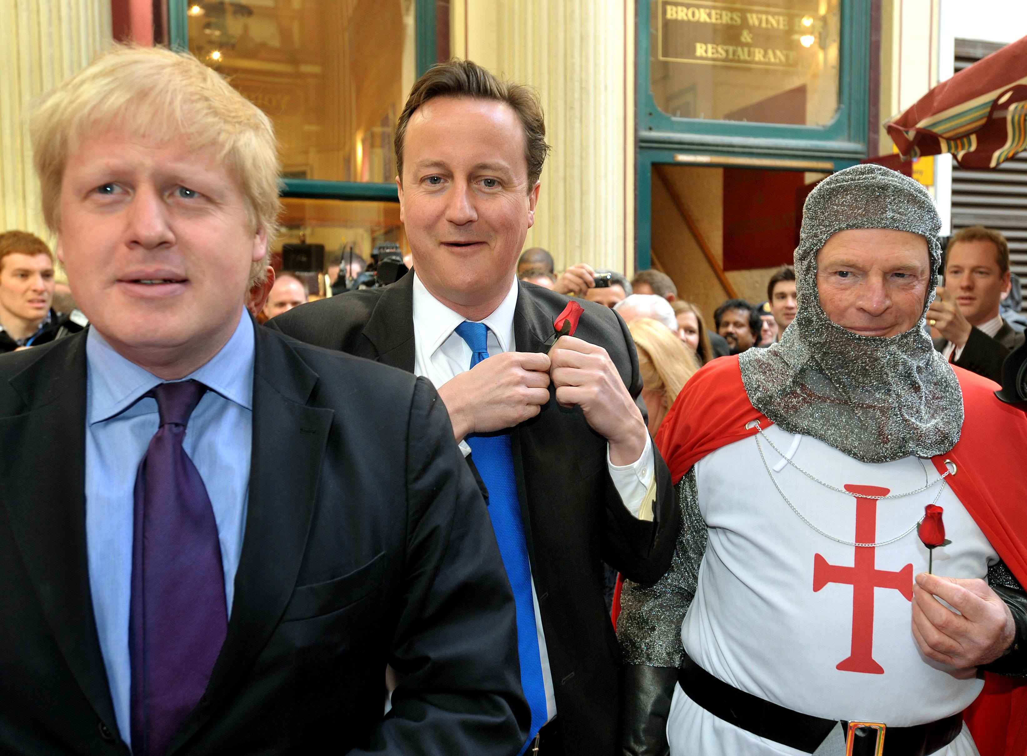 Leader of the Conservative Party David Cameron (centre) with Mayor of London Boris Johnson (left) as they celebrate St George's day in Leadenhall Market in the City of London.
