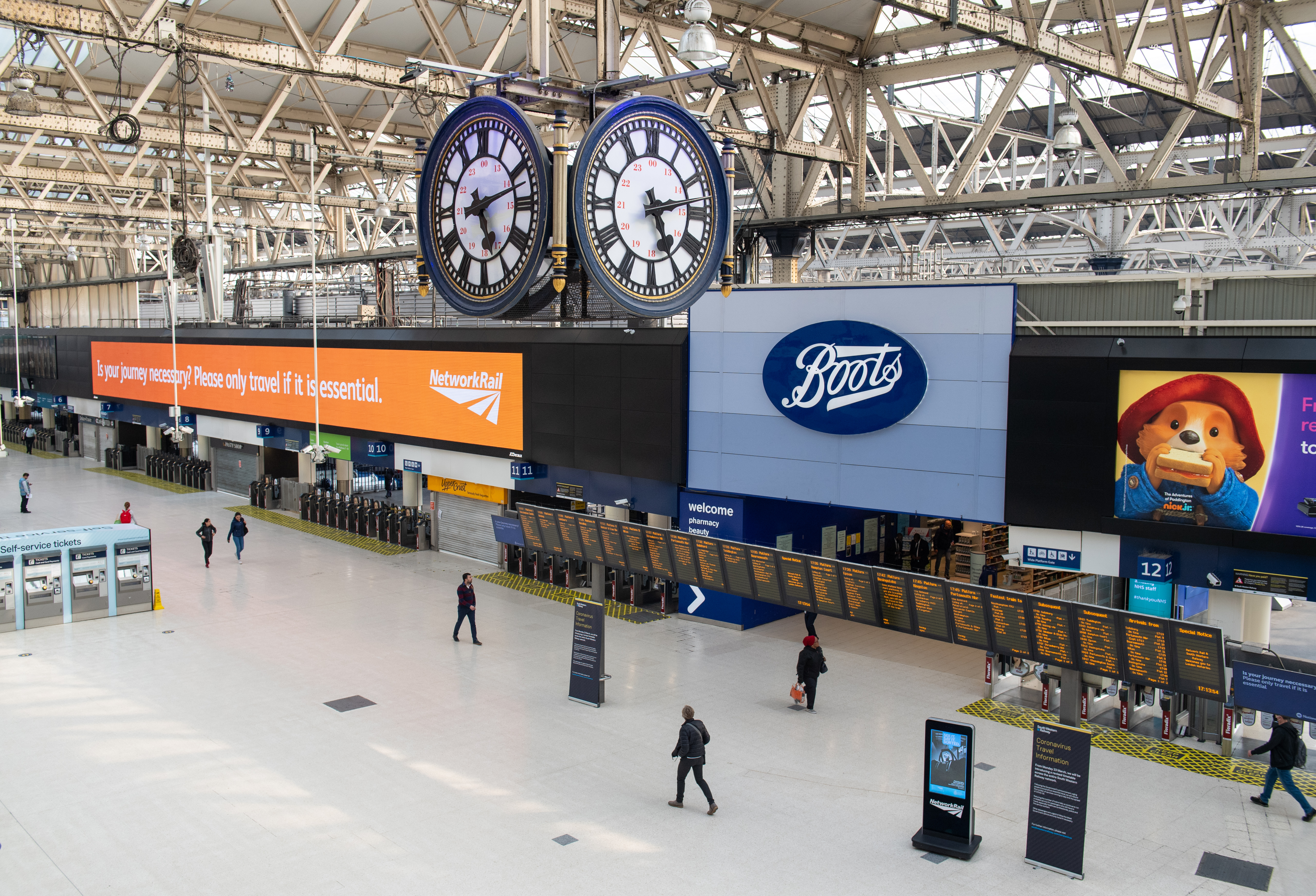 Travellers at a largely empty Waterloo station, in London, as the UK continues in lockdown to help curb the spread of the coronavirus.