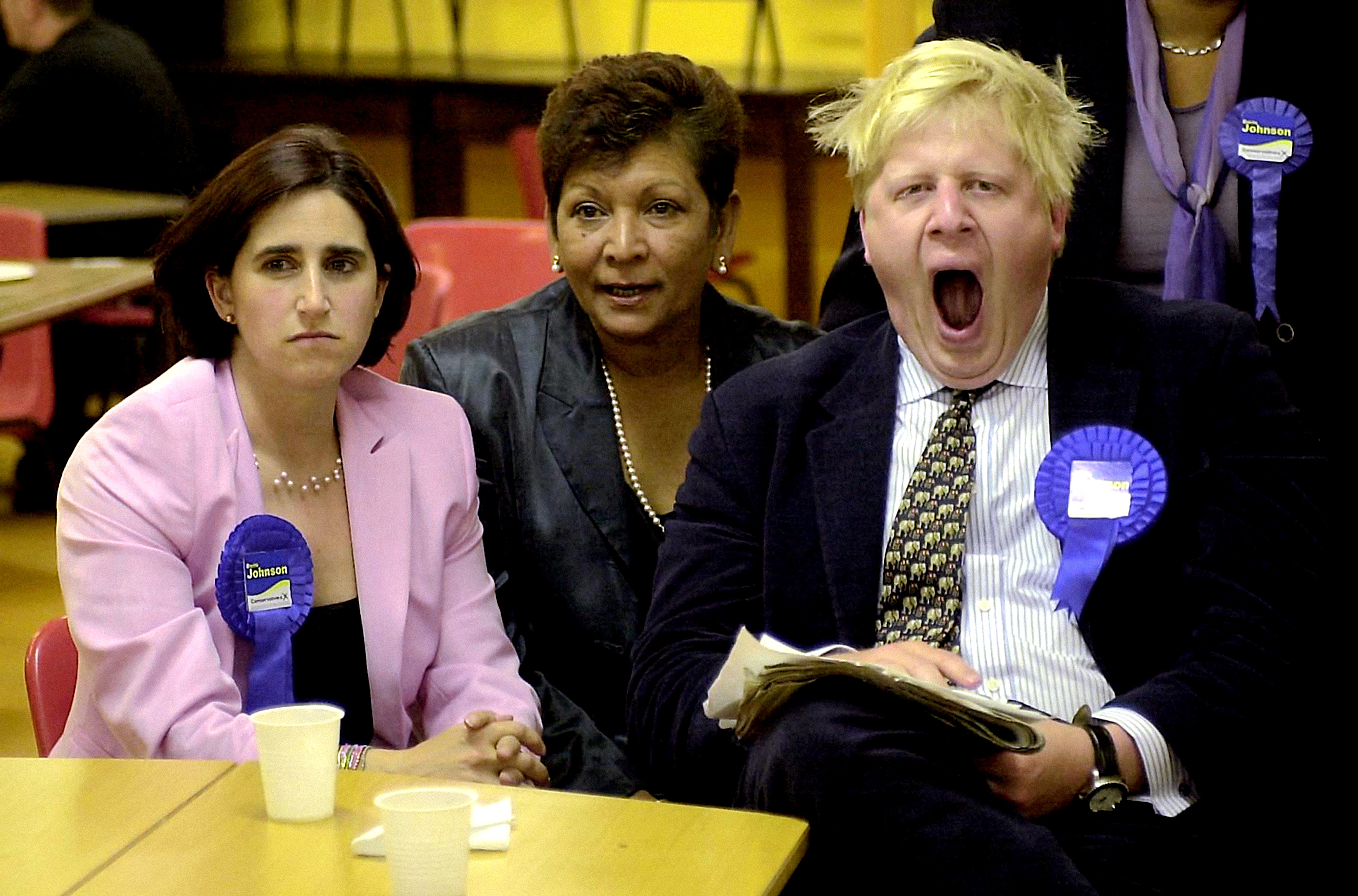 Journalist Boris Johnson yawns while watching the election results in the early hours of the morning with his wife Marina (L), at the count in Watlington, Oxfordshire, after winning the Henley seat for the Conservatives.  * ...in the 2001 General Election. The seat was Michael Heseltine's, who has stepped down at this election.