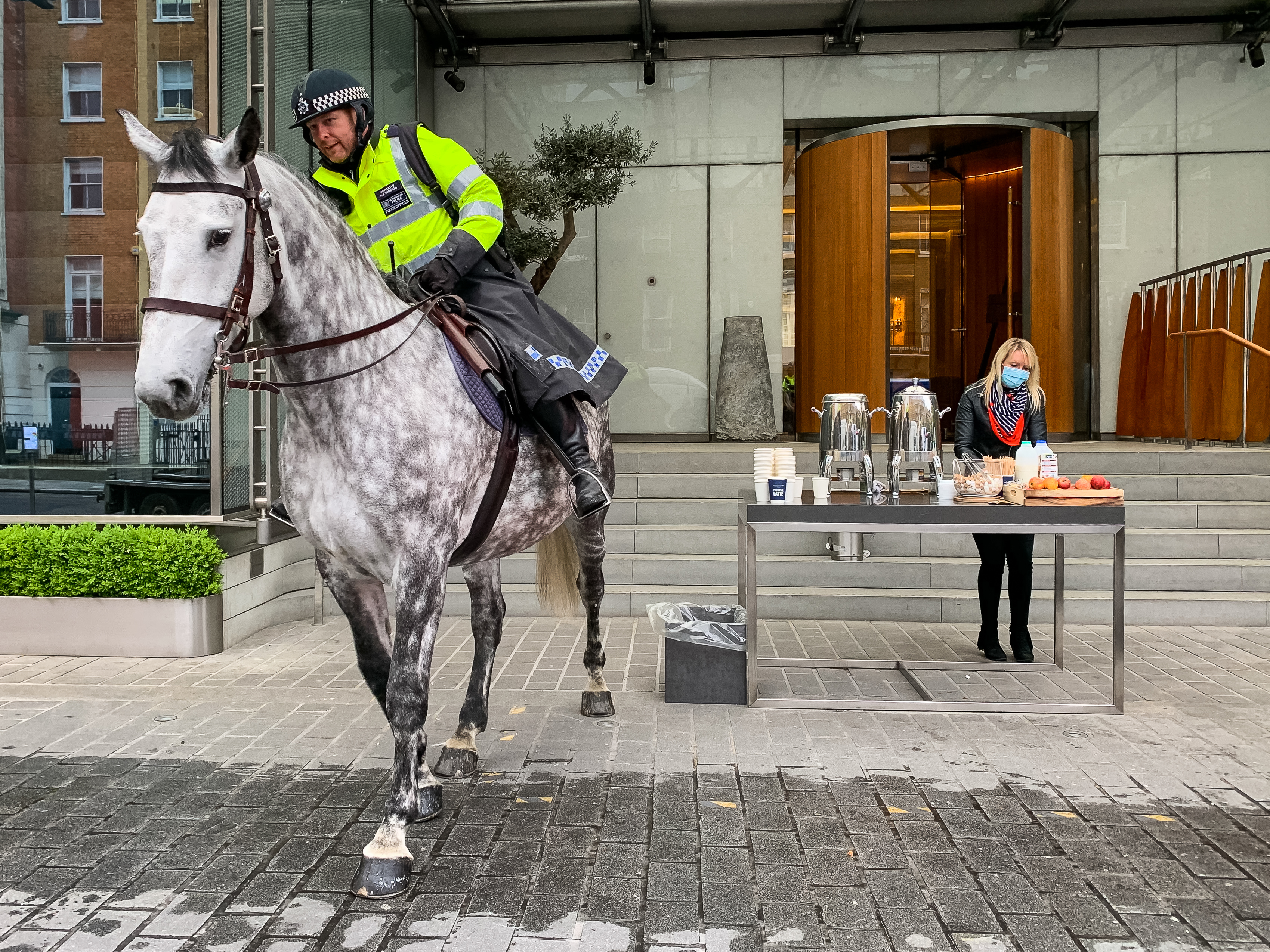 A police horse arrives at a free drive-through for the emergency services at The Berkeley Hotel as the UK continues in lockdown to help curb the spread of the coronavirus.