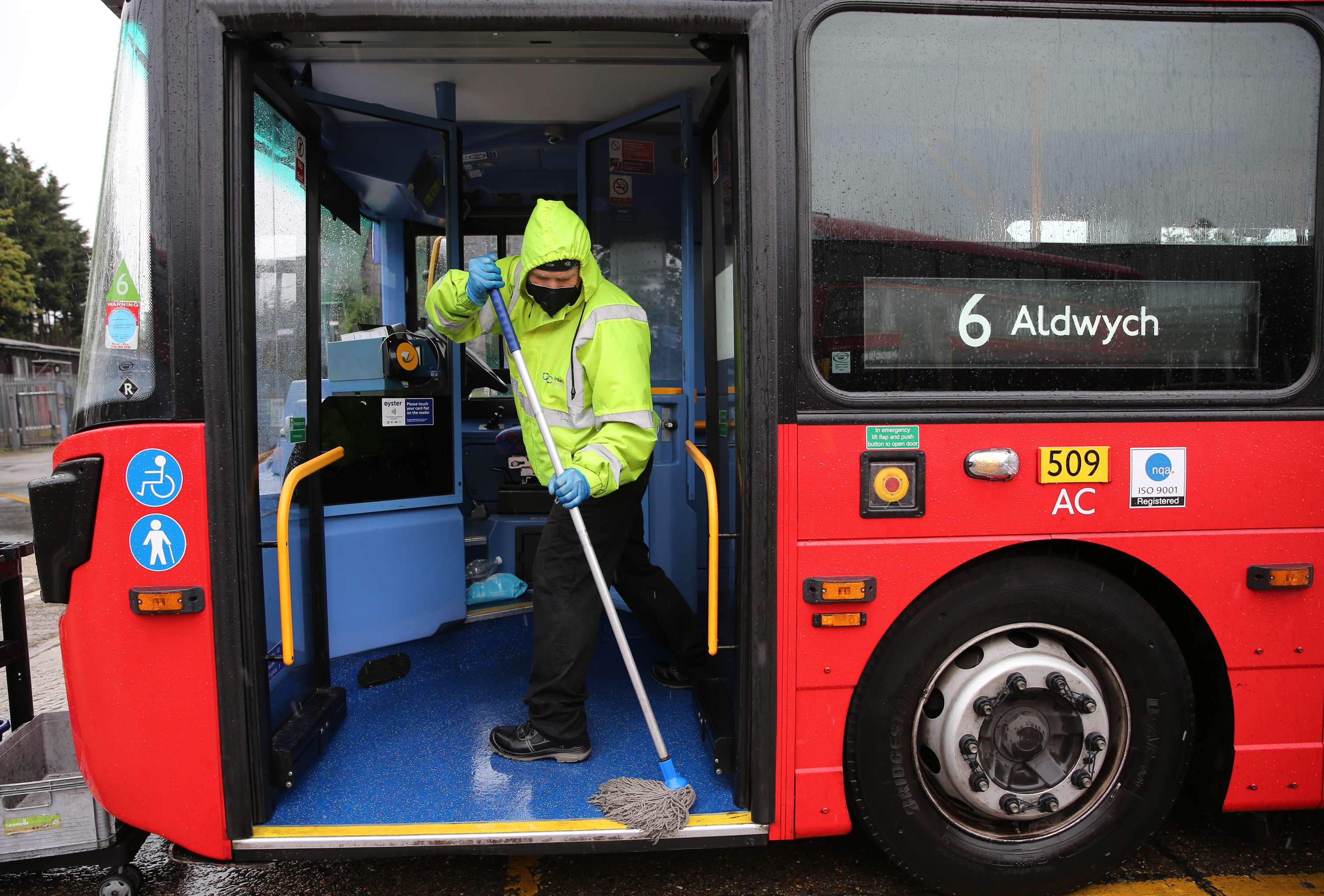 A Metroline worker cleans a bus at Willesden Bus Garage in north west London, as the UK continues in lockdown to help curb the spread of the coronavirus. Picture date: Tuesday April 28, 2020.