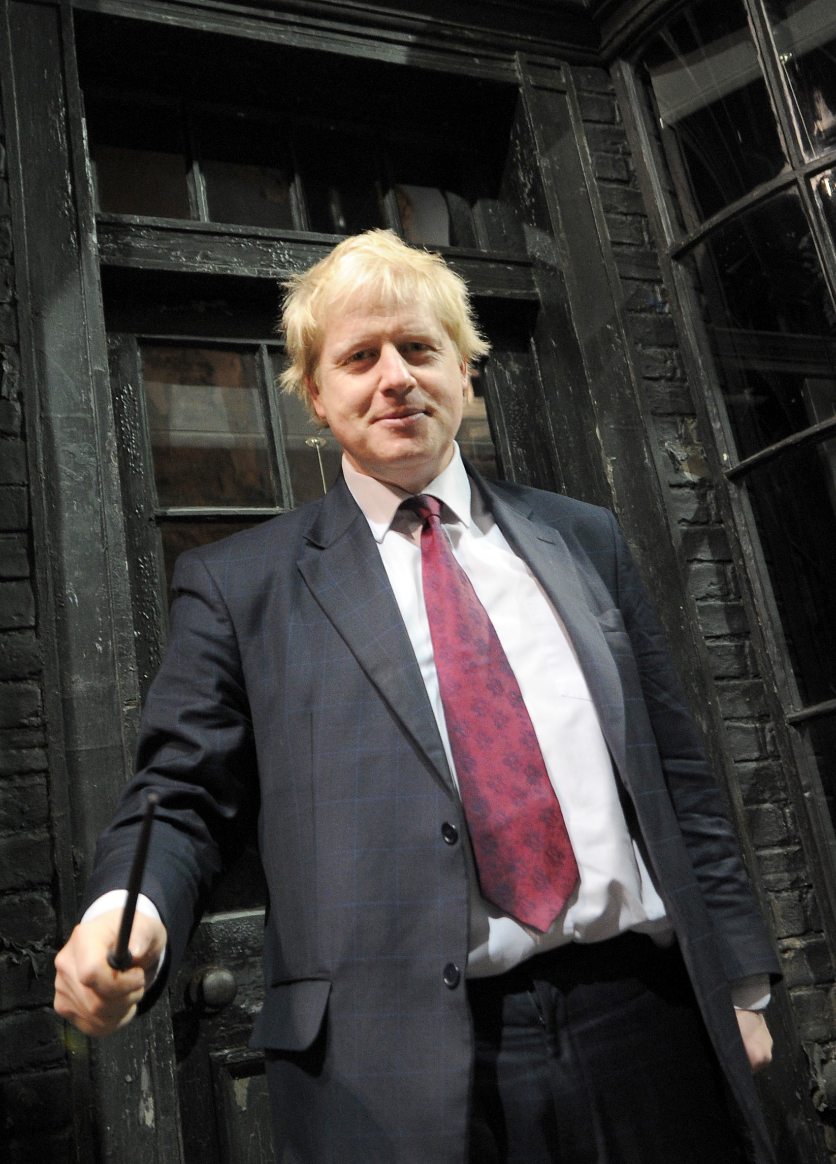 Mayor of London Boris Johnson waves a wand in Diagon Alley as he visits the new attraction 'The Making of Harry Potter' at Warner Brothers studios in Leavesden, Hertfordshire. PRESS ASSOCIATION Photo Monday December 19, 2011. Photo credit should read: Anthony Devlin/PA