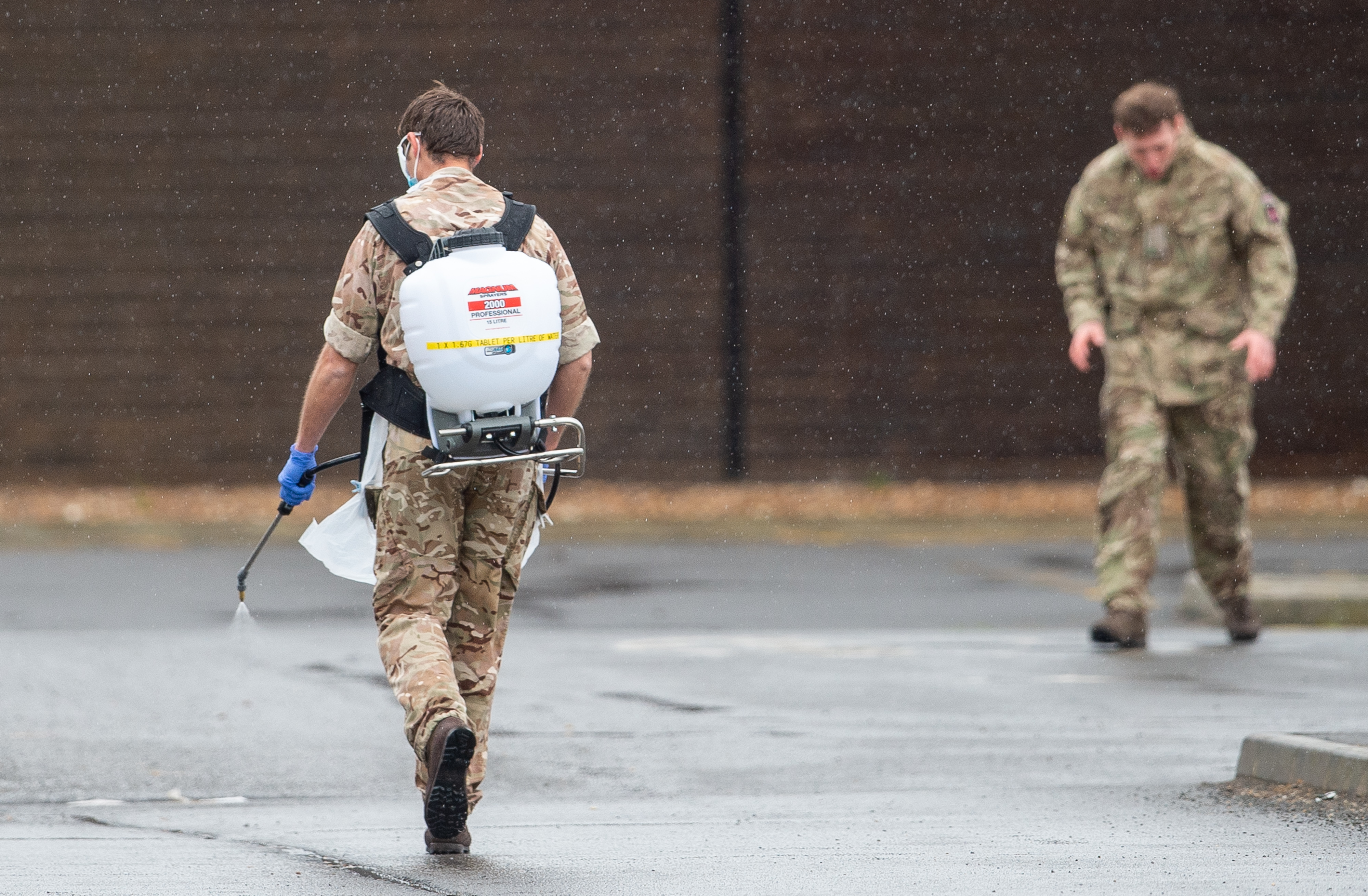 A member of the military sprays disinfectant at a Covid-19 testing centre in Boston, Lincolnshire, as the UK continues in lockdown to help curb the spread of the coronavirus.