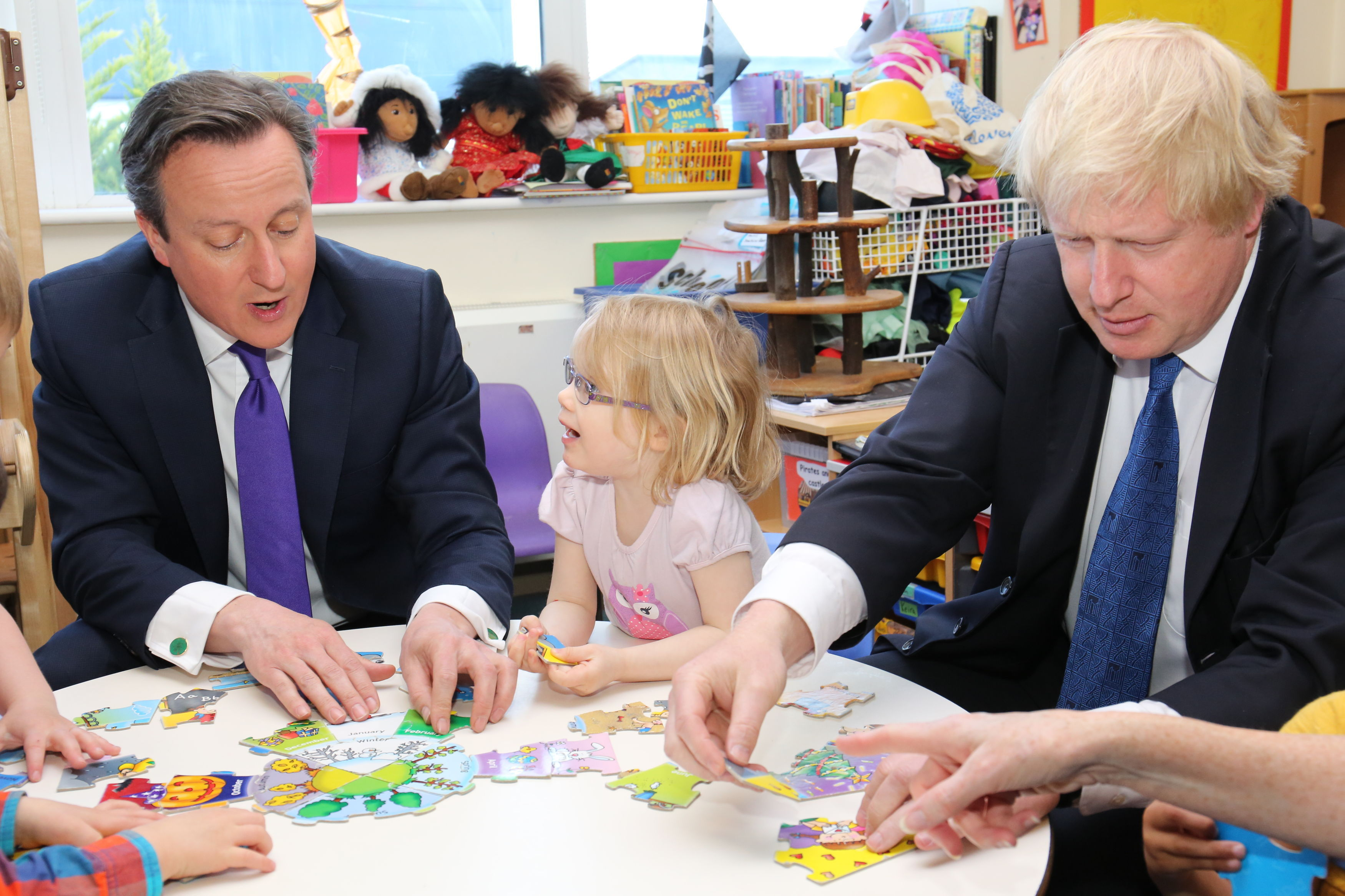 Prime Minister David Cameron (left) and Mayor of London Boris Johnson with 3 year old Staphanie during a General Election campaign visit to Advantage Children's Day Nursery in Surbiton, Surrey.