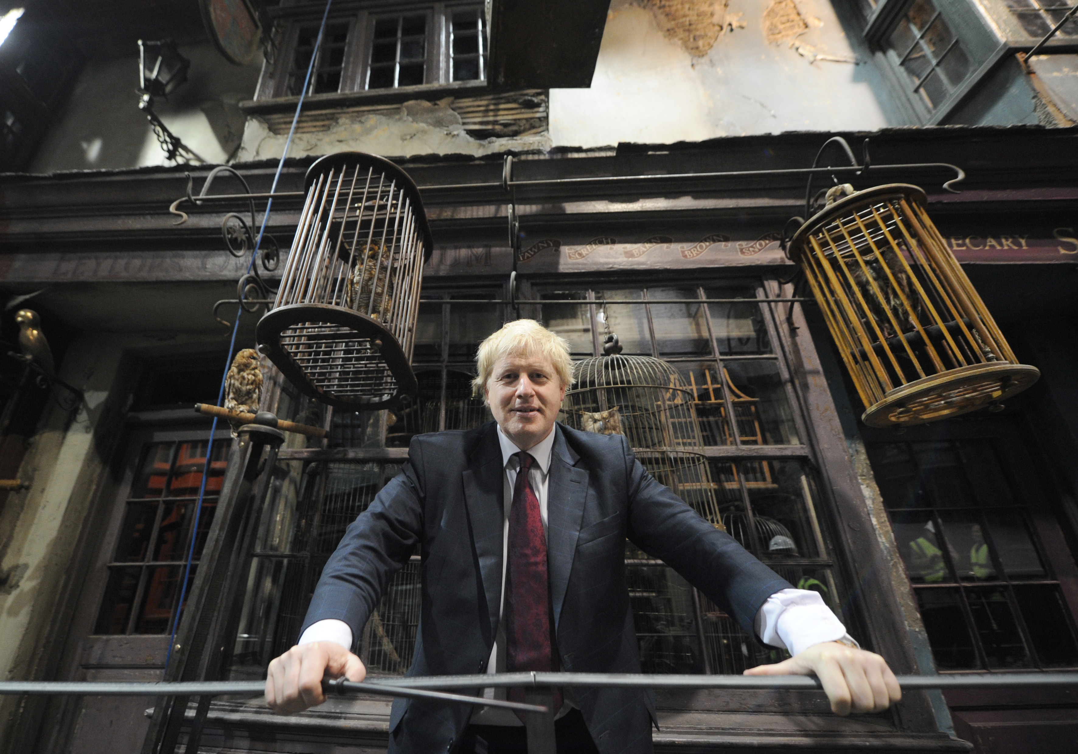 Mayor of London Boris Johnson poses in Diagon Alley as he visits the new attraction 'The Making of Harry Potter' at Warner Brothers studios in Leavesden, Hertfordshire. PRESS ASSOCIATION Photo Monday December 19, 2011. Photo credit should read: Anthony Devlin/PA