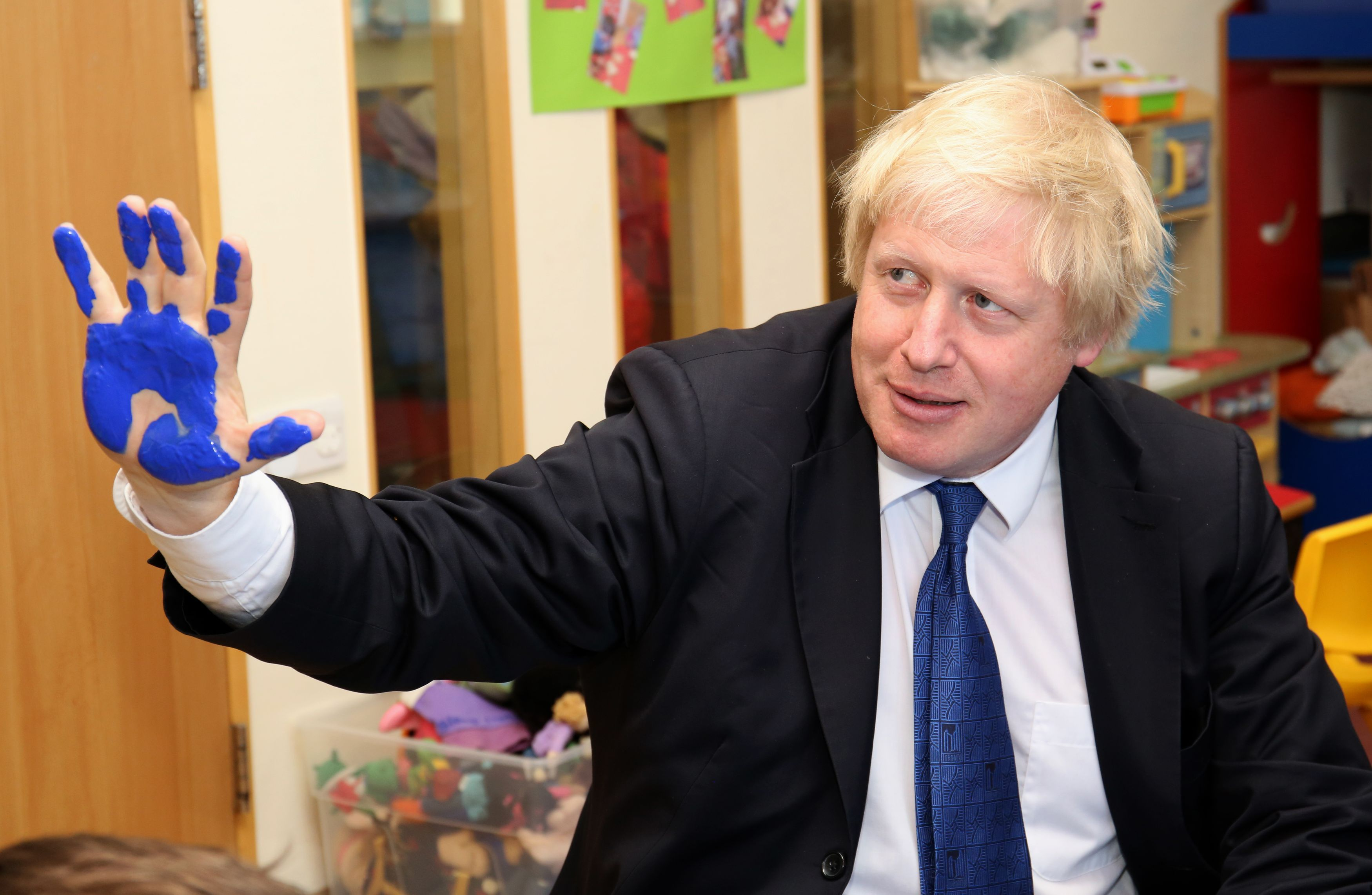 Mayor of London Boris Johnson takes part in a hand painting session during a General Election campaign visit to Advantage Children's Day Nursery in Surbiton, Surrey.