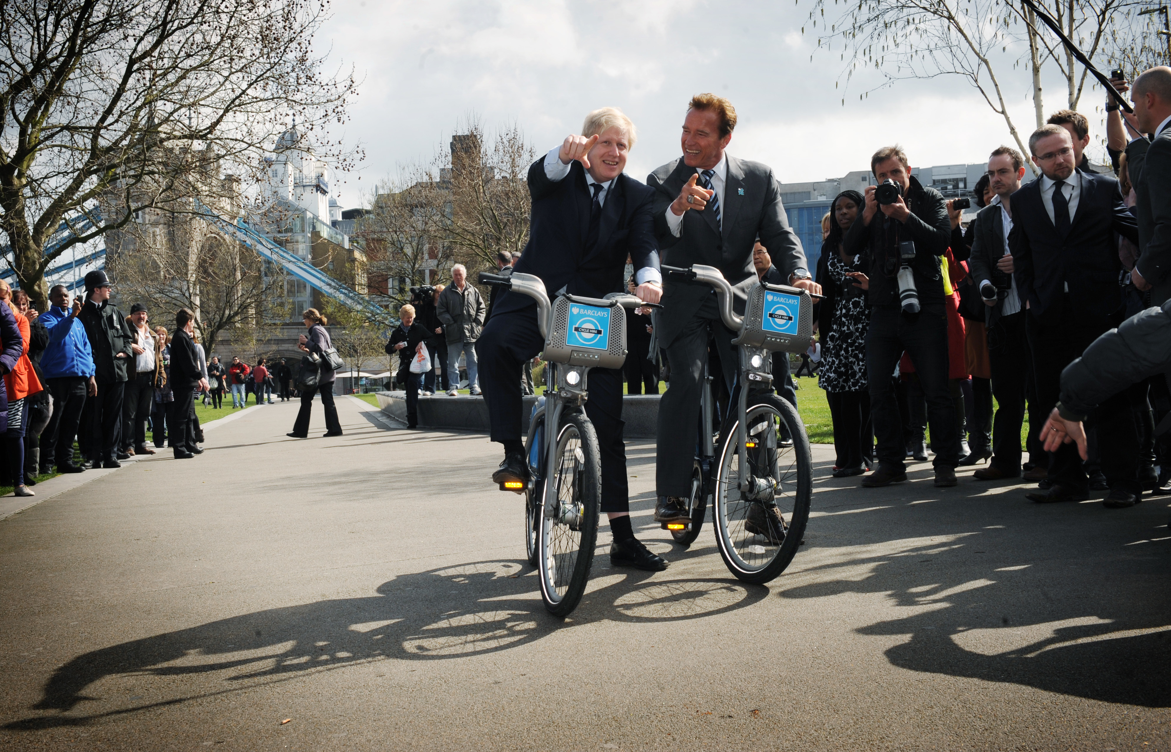 London Mayor Boris Johnson takes former Governor of California Arnold Schwarzenegger (right) for a ride on one of his 'Boris bikes' during his visit to City Hall in London. PRESS ASSOCIATION Photo. Picture date: Thursday March 31, 2011. Photo credit should read: Stefan Rousseau/PA Wire