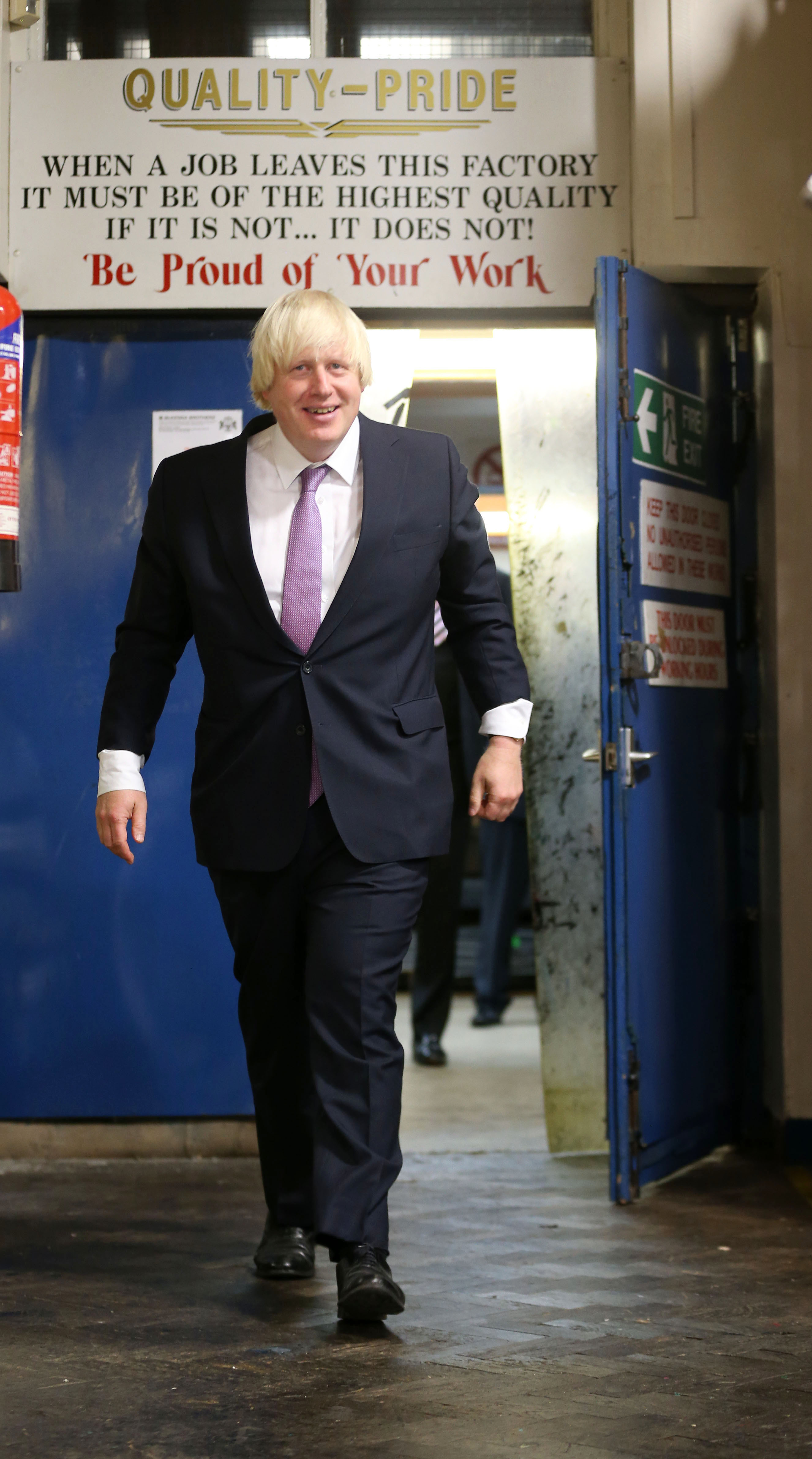Mayor of London Boris Johnson visits McKenna Bothers makers of destination boards in Middleton during the second day of the Conservative Party Conference in Manchester.