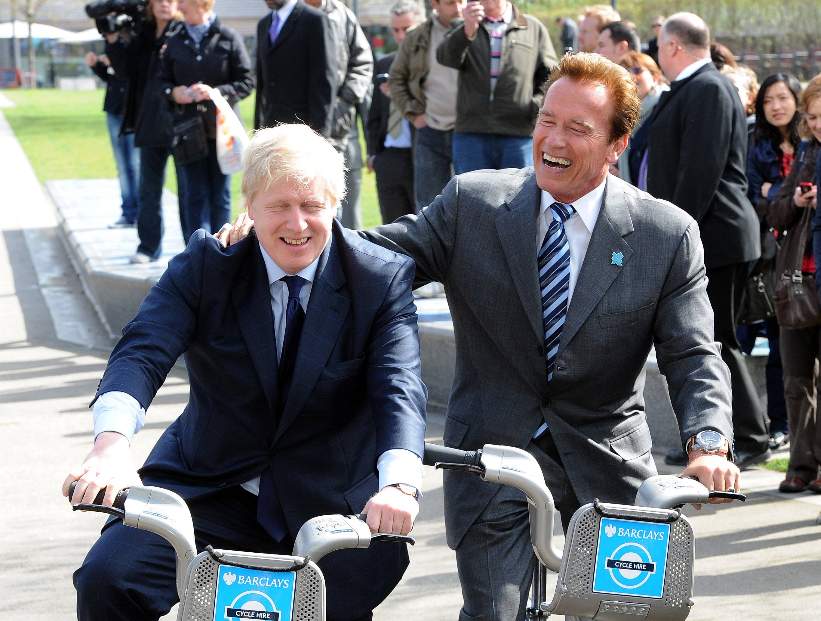 Mayor of London Boris Johnson and Arnold Schwarzenegger (right) on bikes outside City Hall, London.  PRESS ASSOCIATION Photo. Picture date: Thursday March 31, 2011. See PA story POLITICS Arnie. Photo credit should read: Anthony Devlin/PA Wire