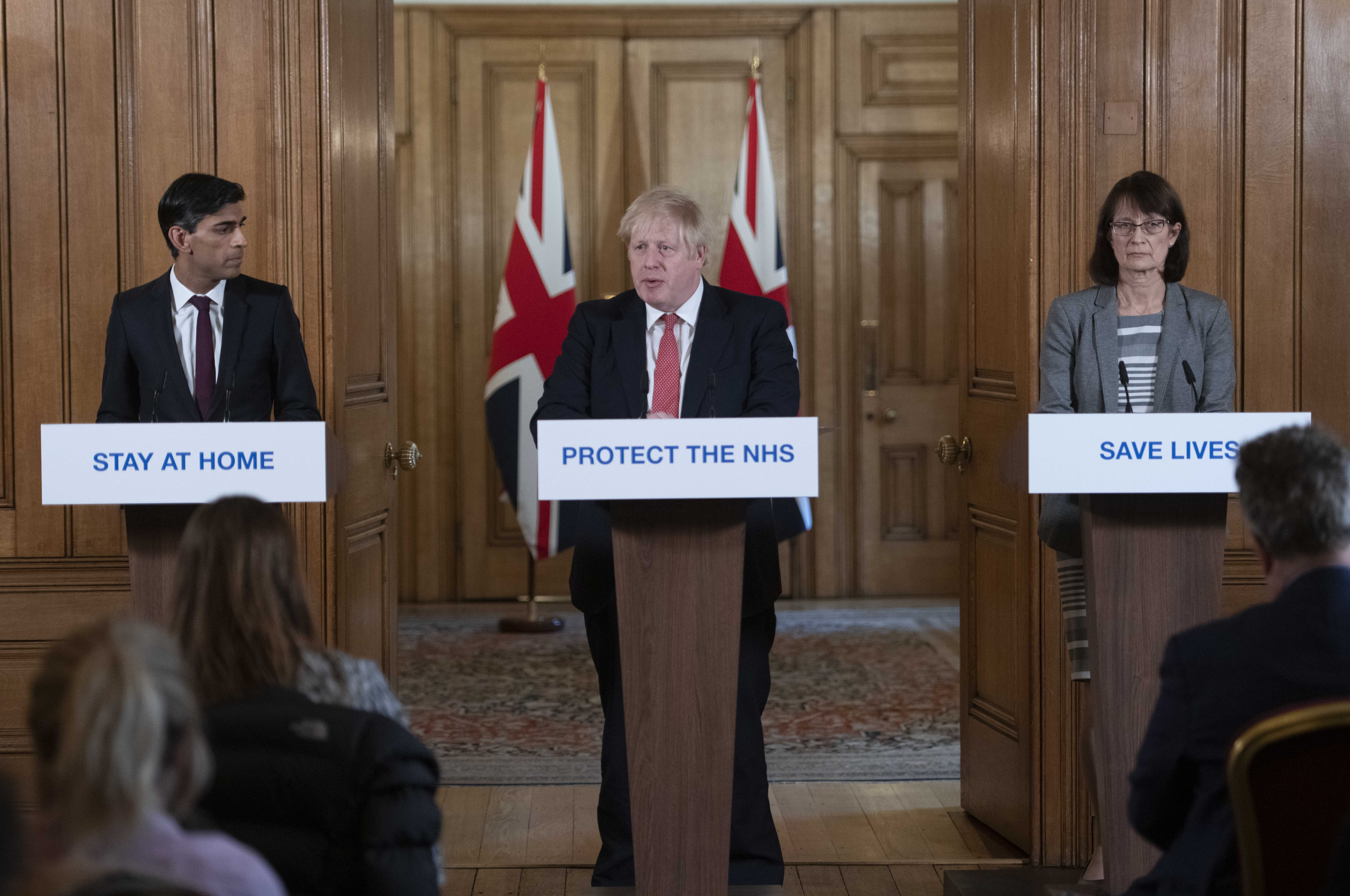 File photo dated 20/03/2020 of Prime Minister Boris Johnson (centre), Chancellor Rishi Sunak (left) and Dr Jenny Harries (right) speaking at a media briefing in Downing Street, London, on coronavirus (COVID-19). The Prime Minister has said he has tested positive for coronavirus.