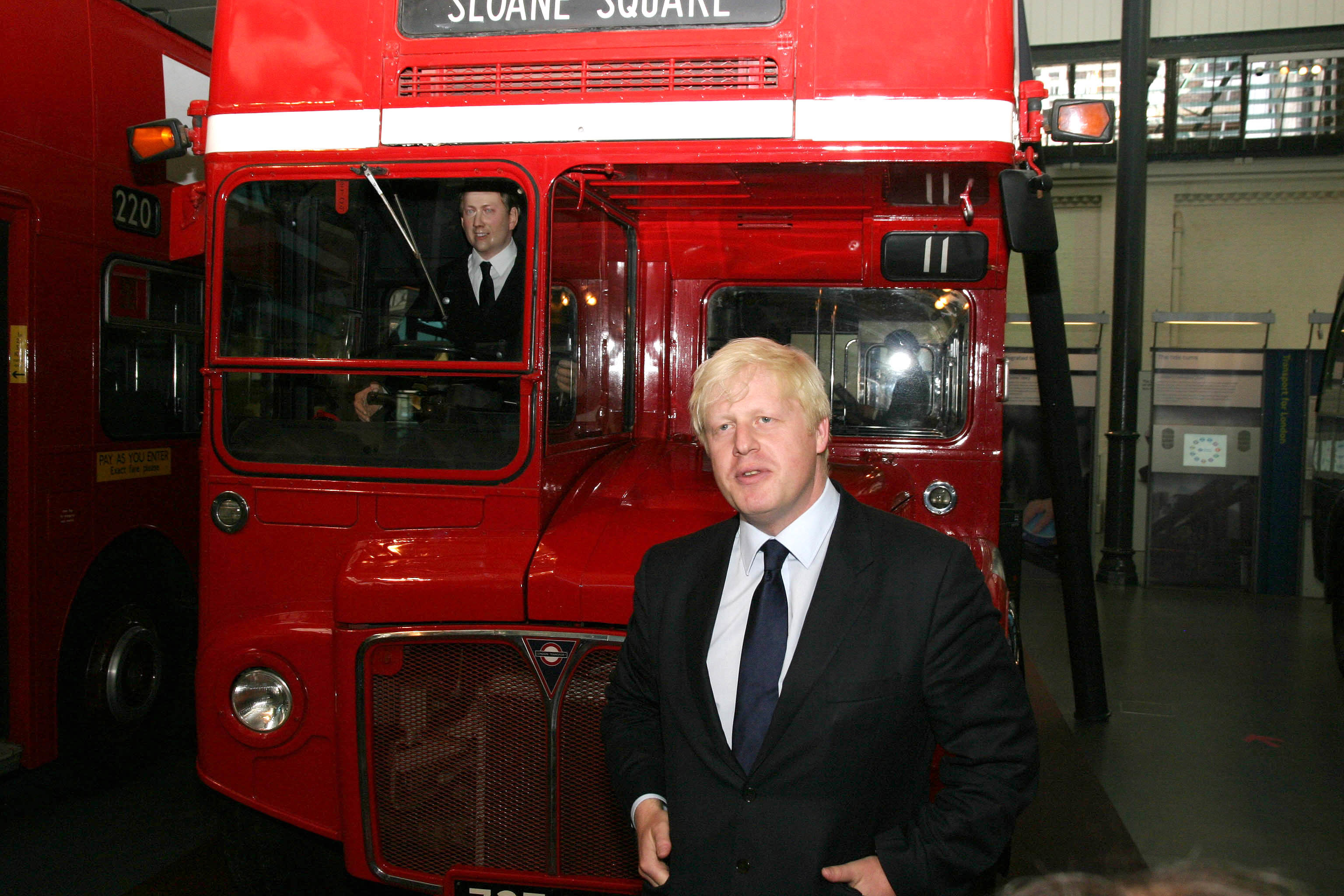 """Mayor of London, Boris Johnson stands in front of a London Transport Routemaster bus, at the London Transport Museum in central London. London mayor Boris Johnson launched a competition today to design a possible new """"green"""" replacement for the """"much missed"""" jump-on, jump-off double-decker Routemaster bus. The red driver-and-conductor Routemasters were withdrawn from regular service in 2005."""