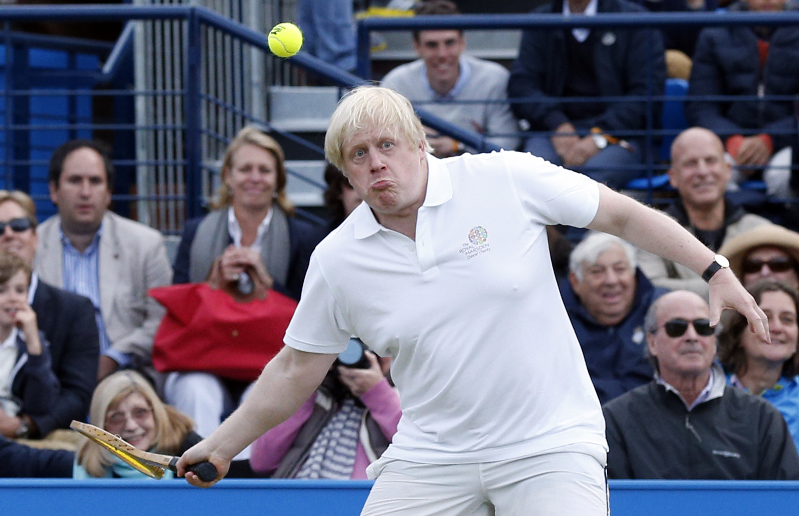 Boris Johnson (centre) takes part in a celebrity tennis match in aid of the Royal Marsden Hospital at The Queen's Club, London.
