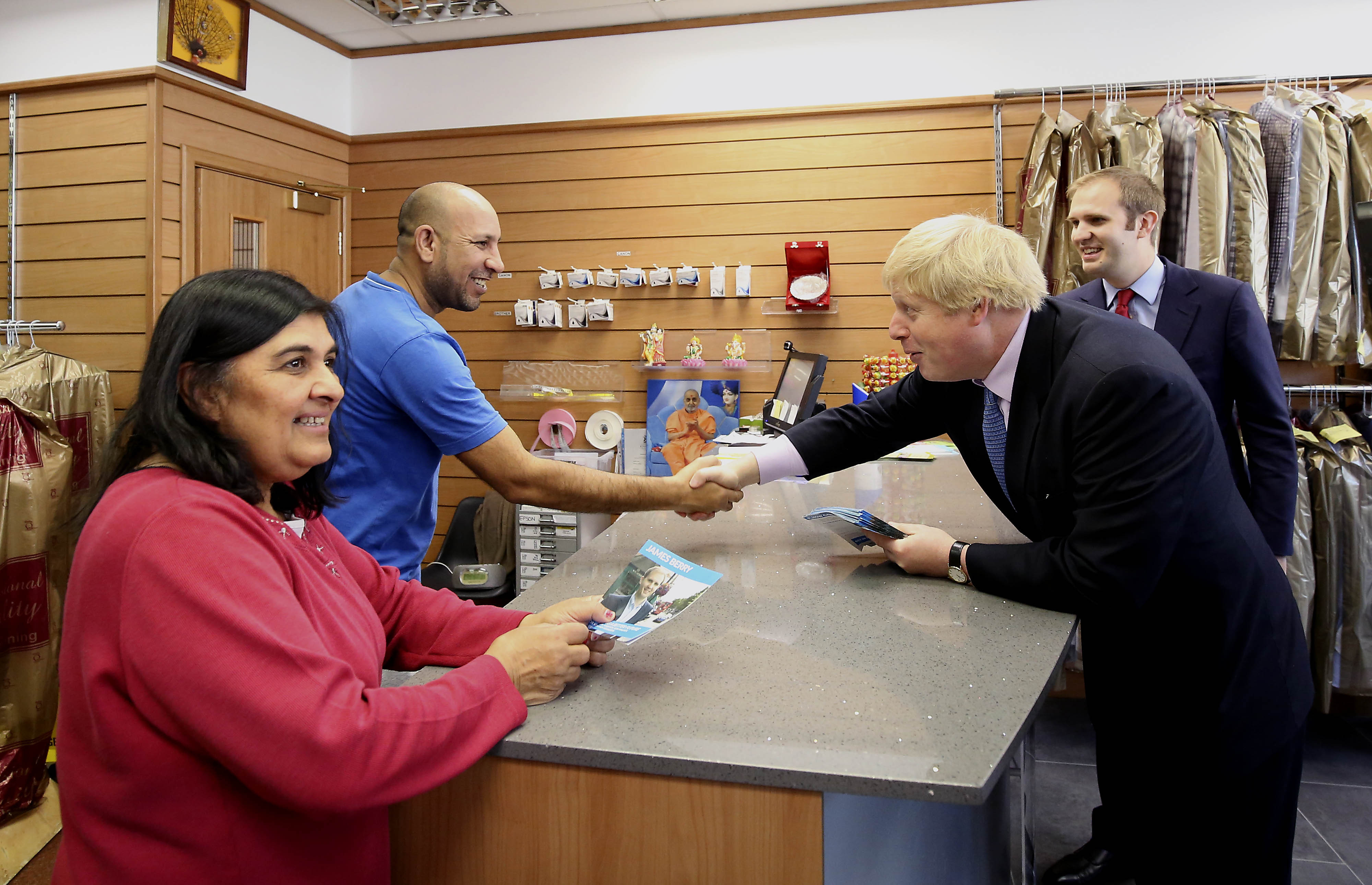 Mayor of London Boris Johnson with Conservative candidate for Kingston and Surbiton James Berry (right) talking to local shopkeepers while on the General Election campaign trail in New Malden in south-west London.