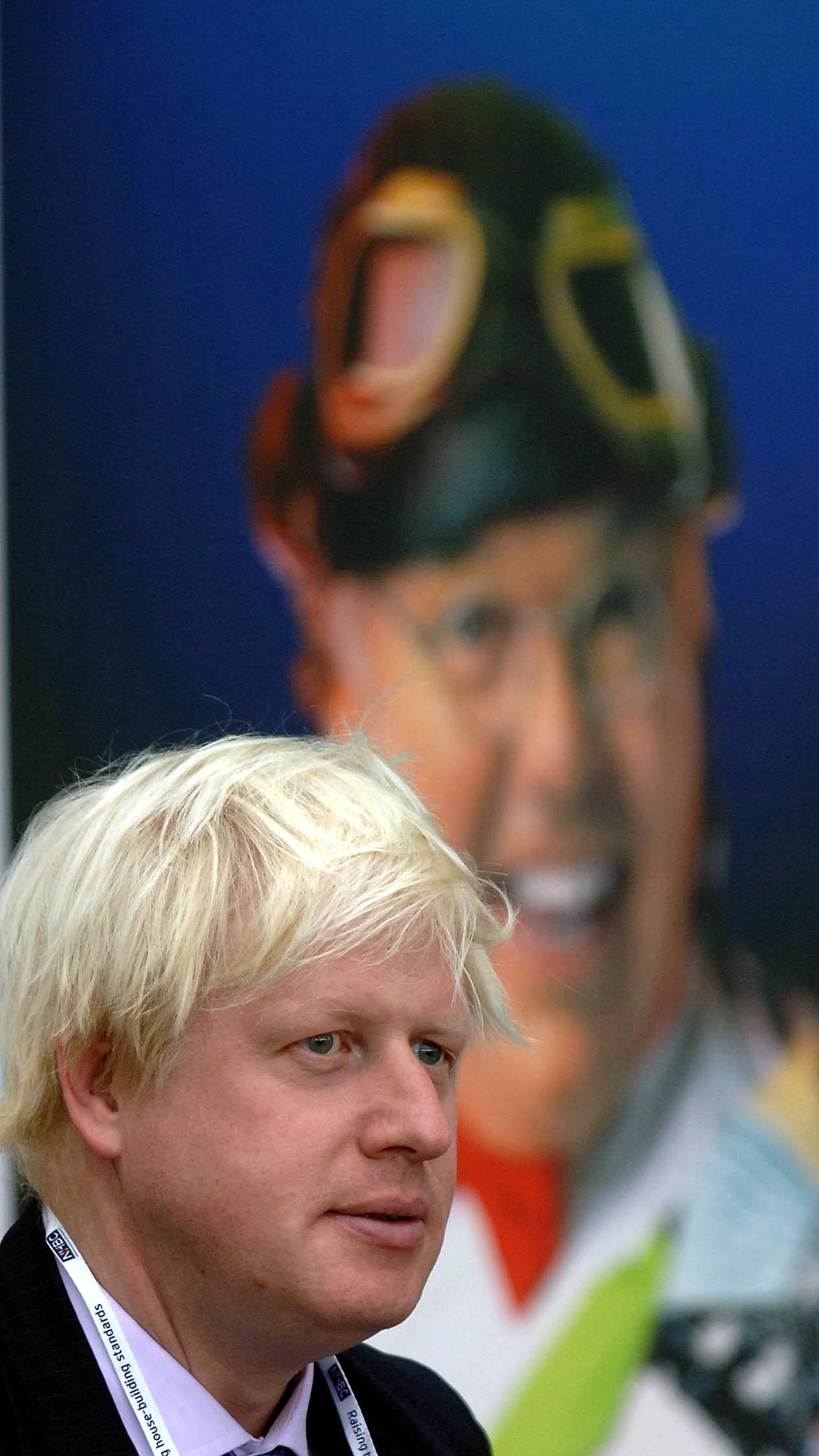 """Boris Johnson the Conservative MP for Henley in front of a poster for Pier Comedian Roy Chubby Brown in Blackpool, Monday 3 October 2005 on the first day of the Conservative Conference. Colourful Tory MP Boris Johnson today said he found the idea that Gordon Brown could defeat any leader of the Conservative Party in a General Election """"absolutely unbelievable"""". The member for Henley and Spectator editor, who is backing David Cameron's leadership bid, said that he was not in favour of would-be leaders trying to mimic Tony Blair but called for a new approach to Conservatism. Speaking at a conference fringe meeting, he predicted success for the Tories next time the country goes to polls. He said: """"I think the Tories are going to win the next election. See PA Story TORY Boris. PRESS ASSOCIATION Photo. Photo credit should read: PA."""