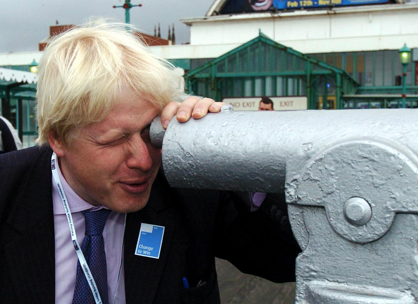 """Boris Johnson the Conservative MP for Henley looks through a telescope on the North Pier at Blackpool, Monday 3 October 2005 on the first day of the Conservative Conference. Colourful Tory MP Boris Johnson today said he found the idea that Gordon Brown could defeat any leader of the Conservative Party in a General Election """"absolutely unbelievable"""". The member for Henley and Spectator editor, who is backing David Cameron's leadership bid, said that he was not in favour of would-be leaders trying to mimic Tony Blair but called for a new approach to Conservatism. Speaking at a conference fringe meeting, he predicted success for the Tories next time the country goes to polls. He said: """"I think the Tories are going to win the next election. See PA Story TORY Boris. PRESS ASSOCIATION Photo. Photo credit should read: PA."""