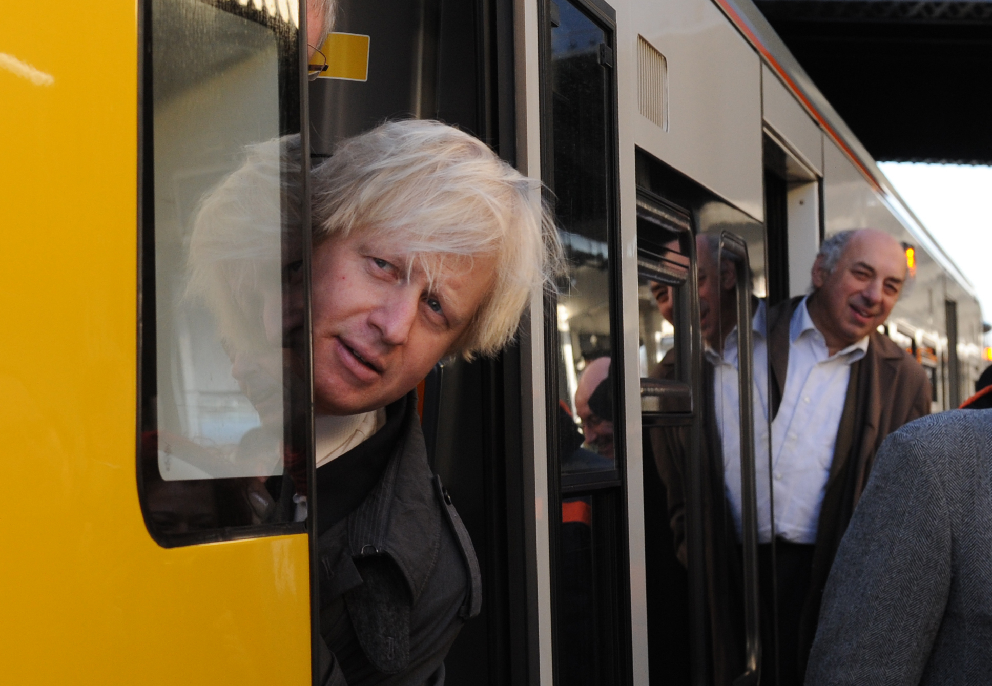 London Mayor Boris Johnson boards one of the first trains of the new London Overground extension connecting Clapham Junction with Canada Water. ASSOCIATION Photo. Picture date: Monday December 10 2012. The new service will be London's first new orbital Journey times from south and east London. See PA story RAIL Link. Photo credit should read: Stefan Rousseau/PA