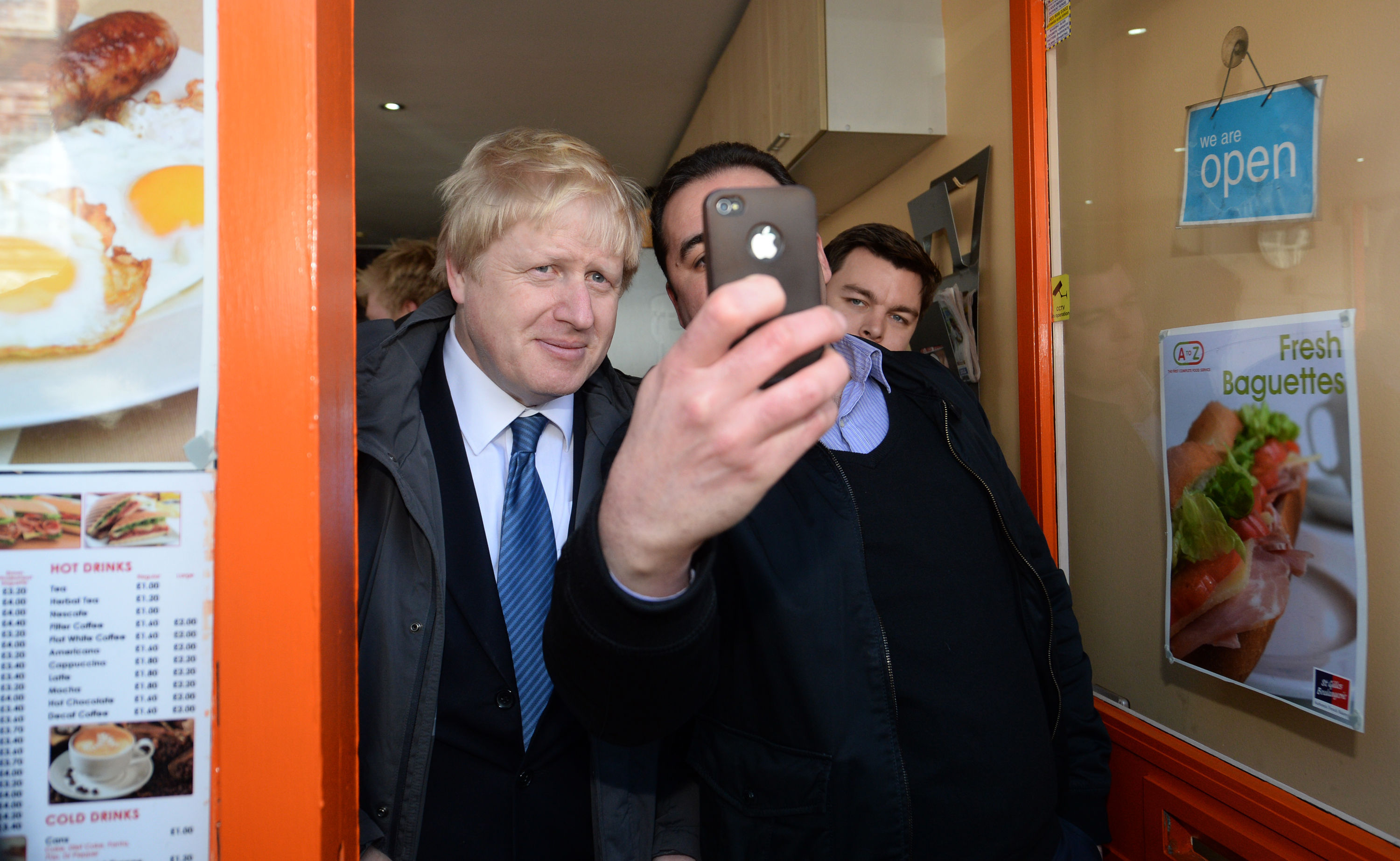 Mayor of London Boris Johnson has a selfie taken with a member of the public after launching the Conservative London campaign at Hartley Hall in Mill Hill, London.