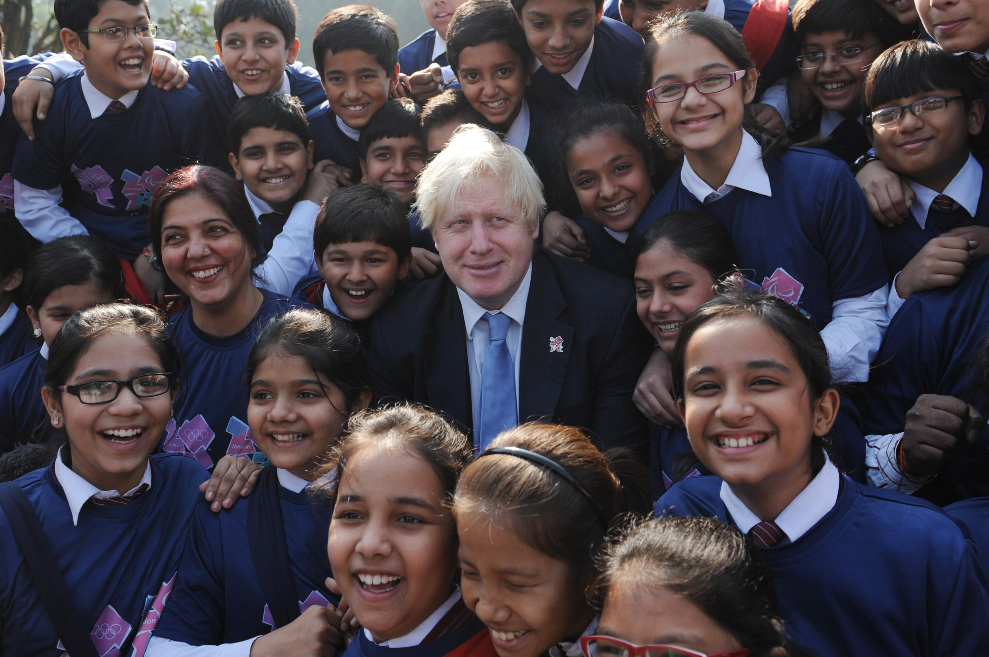 London Mayor Boris Johnson is mobbed by school children in Delhi today after he handed over the London 2012 Olympic cauldron petals to Indian Olympians. The petals which were part of the Thomas Heatherwick designed cauldron which burnt throughout the Olympic and Paralympic Games will be given to every competing nation.