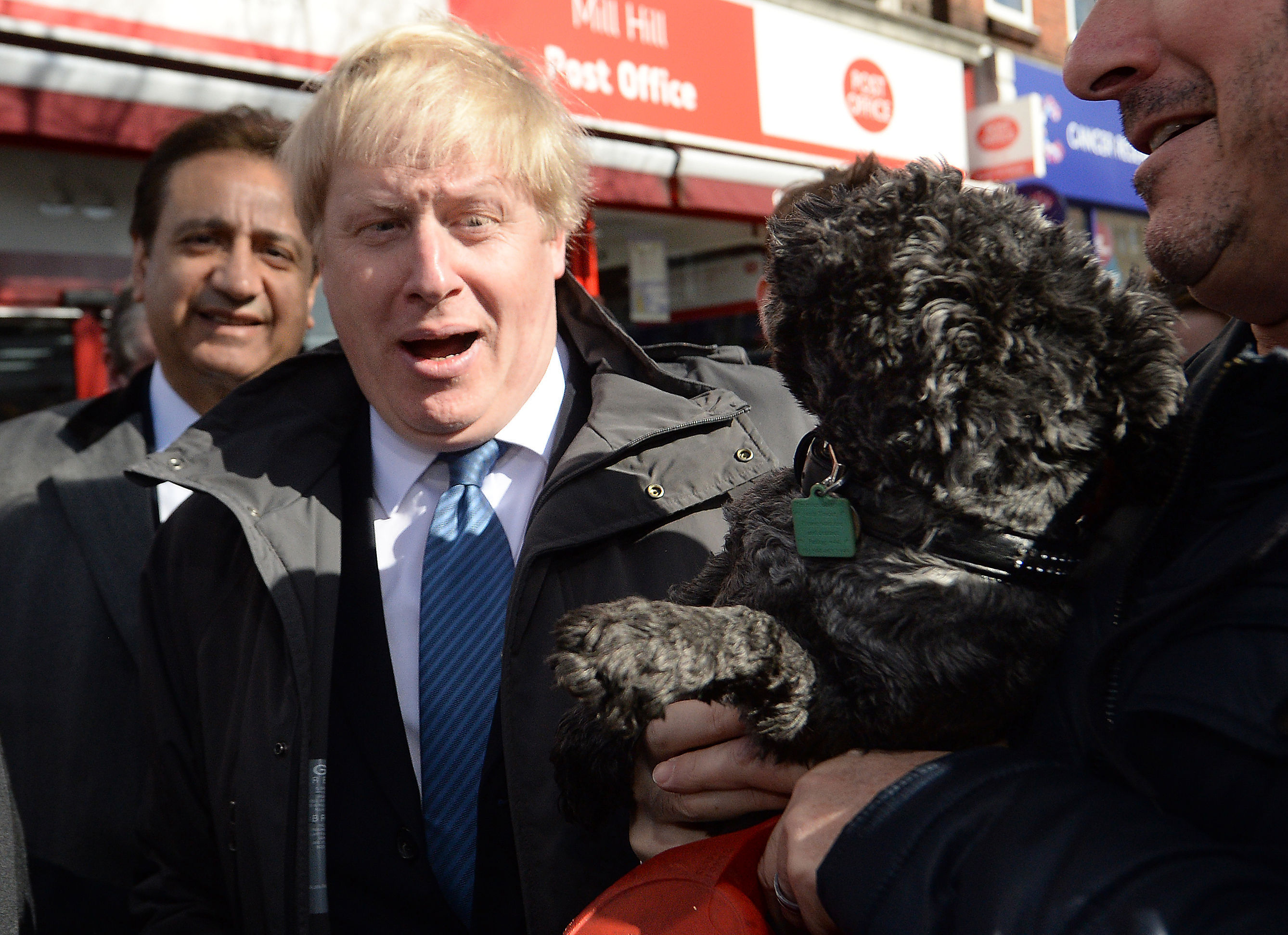 Mayor of London Boris Johnson after being licked by a dog as he meets members of the public and local business owners after launching the Conservative London campaign at Hartley Hall in Mill Hill, London.