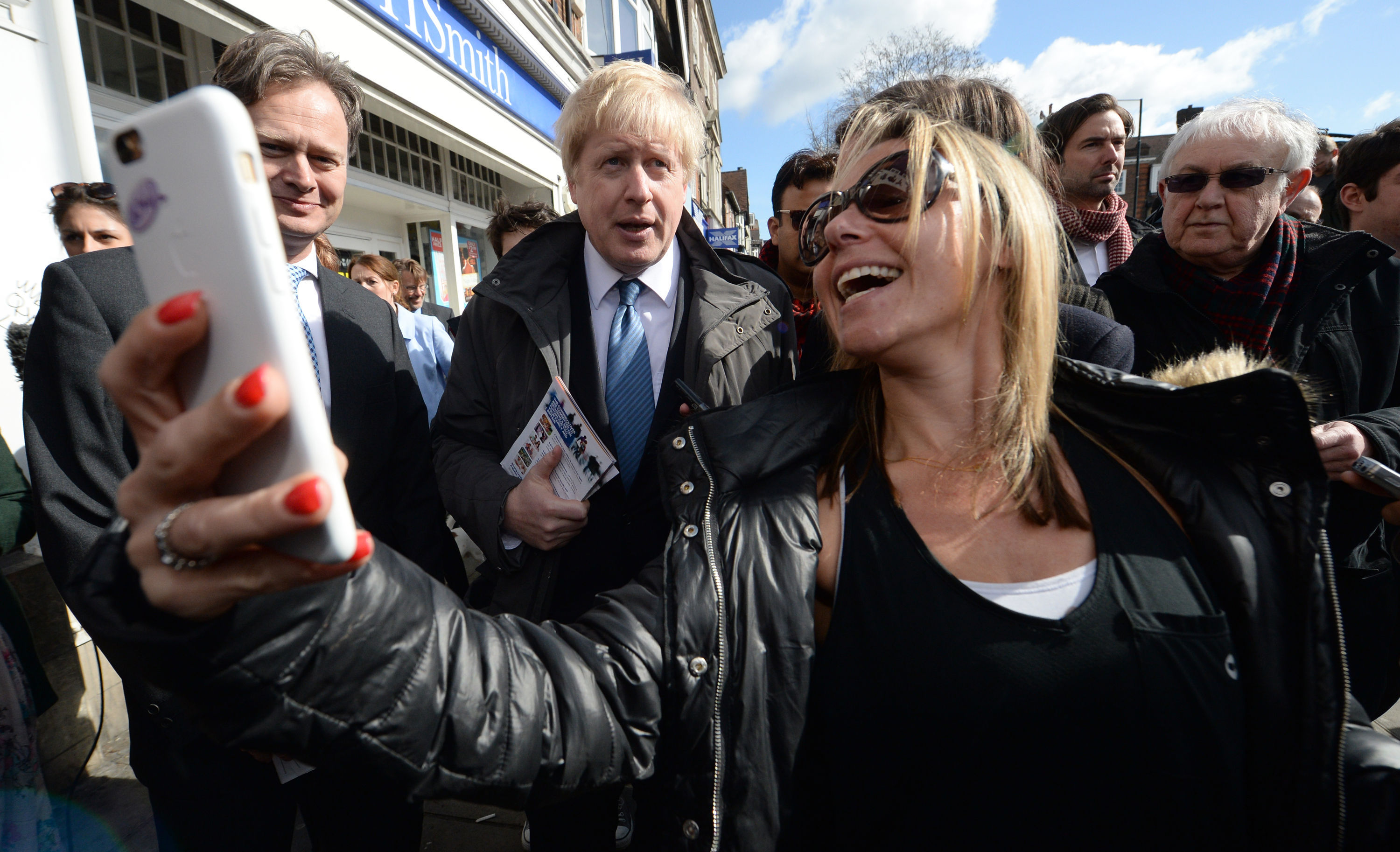 A member of the public takes a photo on their mobile phone of Mayor of London Boris Johnson after he launched the Conservative London campaign at Hartley Hall in Mill Hill, London.