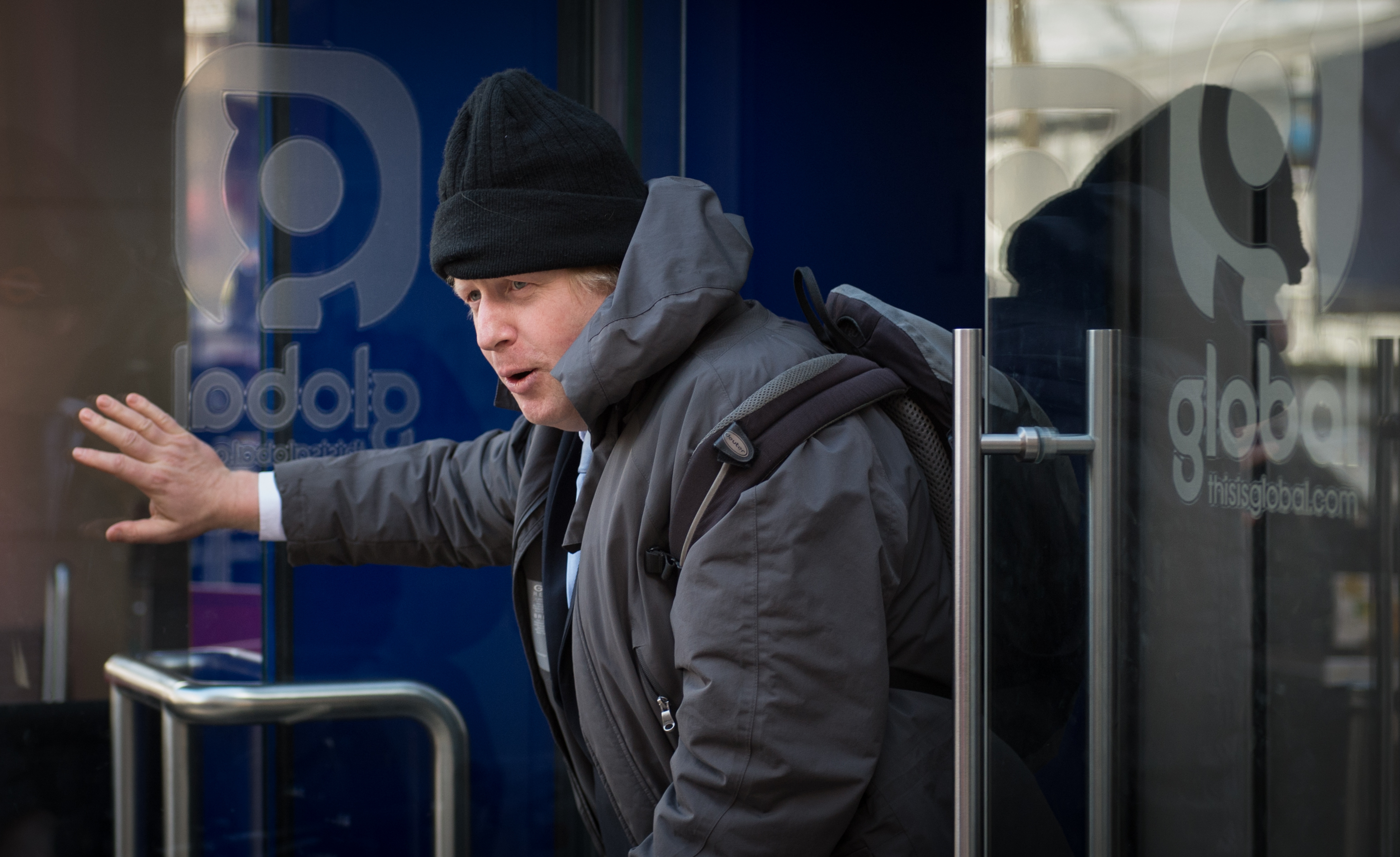 Mayor of London Boris Johnson leaves Global Radio studios in central London after presenting his regularly phone-in show for LBC radio following David Cameron comments that he is ruling out a third term as Prime Minister.