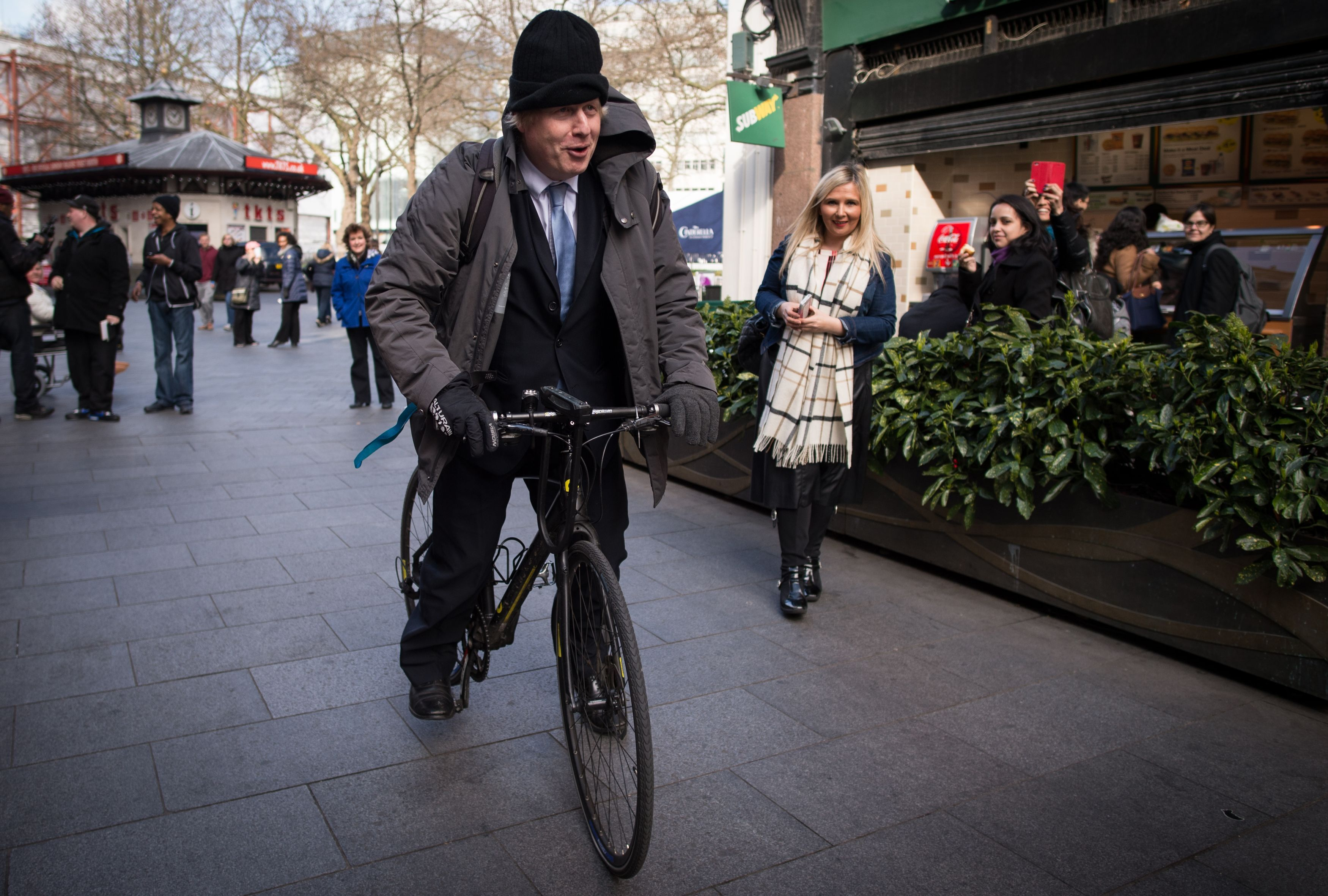 Mayor of London Boris Johnson on his bicycle as he leaves Global Radio studios in central London after presenting his regularly phone-in show for LBC radio following David Cameron comments that he is ruling out a third term as Prime Minister.