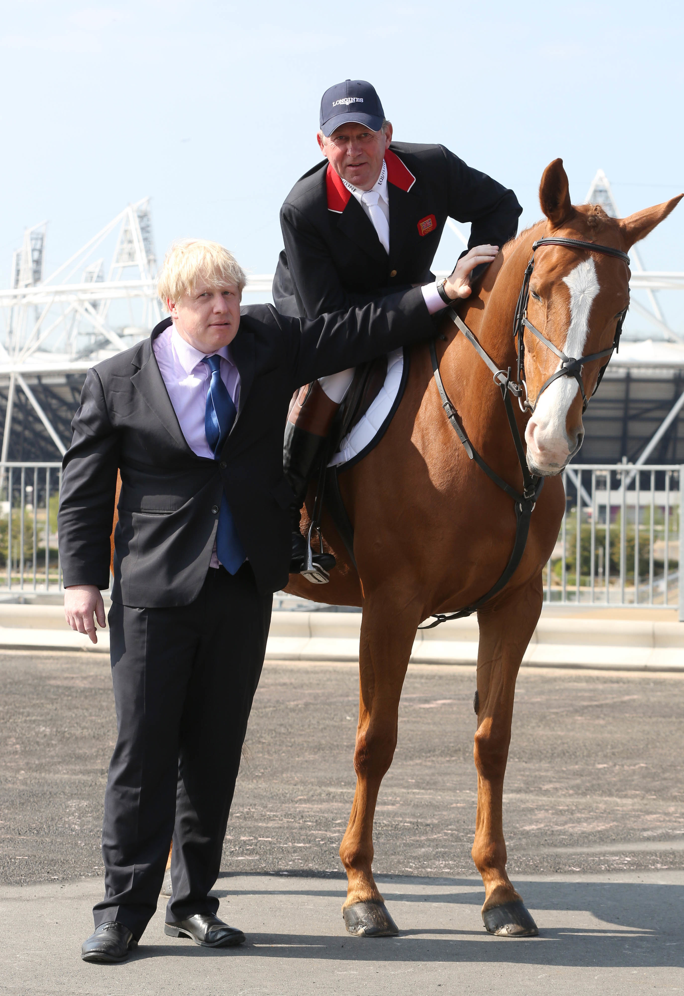 EDITORIAL USE ONLY Olympic Gold medalist Nick Skelton and Mayor of London Boris Johnson at the launch of the Longines Global Champions Tour, an international show jumping event that will take place in The International Quarter adjacent to Queen Elizabeth Olympic Park in east London, from 6th Ð 9th June 2013.