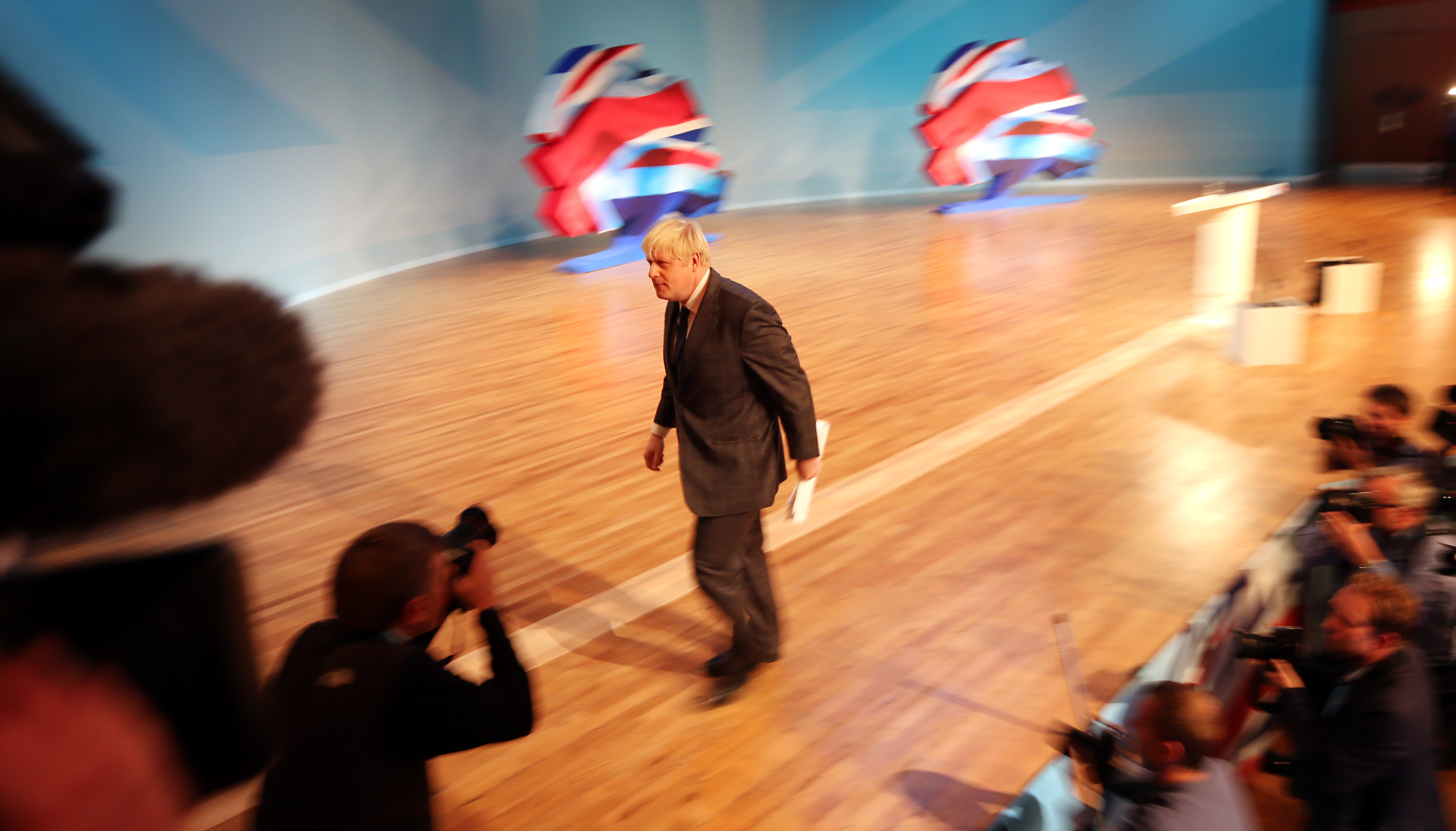 Mayor of London Boris Johnson leaves the stage after addressing the Conservative Party conference at the International Convention Centre in Birmingham.